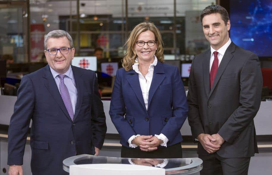 Le maire sortant, Régis Labeaume, la chef de Démocratie Québec, Anne Guérette, et le chef de Québec 21, Jean-François Gosselin, photographiés juste avant le début du débat, mardi soir