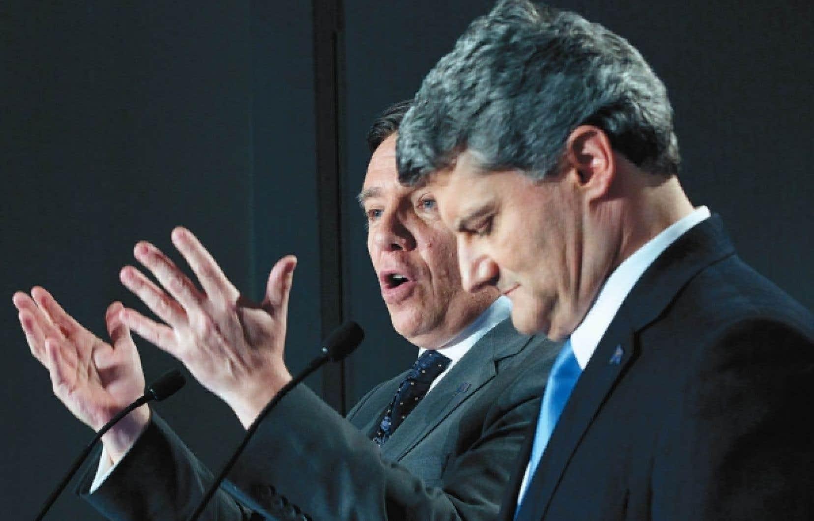 Le chef de la CAQ, François Legault, et celui de l'ADQ, Gérard Deltell, étaient côte à côte hier, à Québec, pour annoncer la conclusion de l'entente de principe sur la fusion des deux partis. M. Deltell agira comme chef parlementaire de la CAQ.<br />