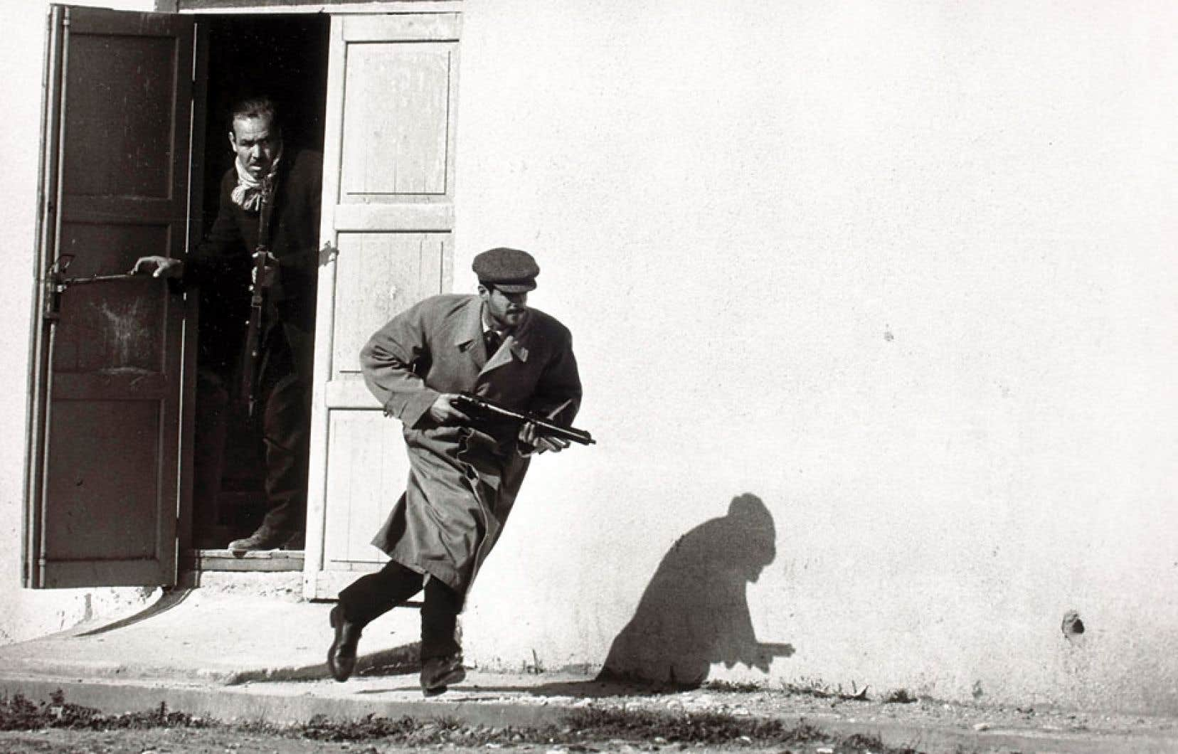Don McCullin, Turkish defender leaving the side-entrance of a cinema, Limassol, Cyprus, 1964.