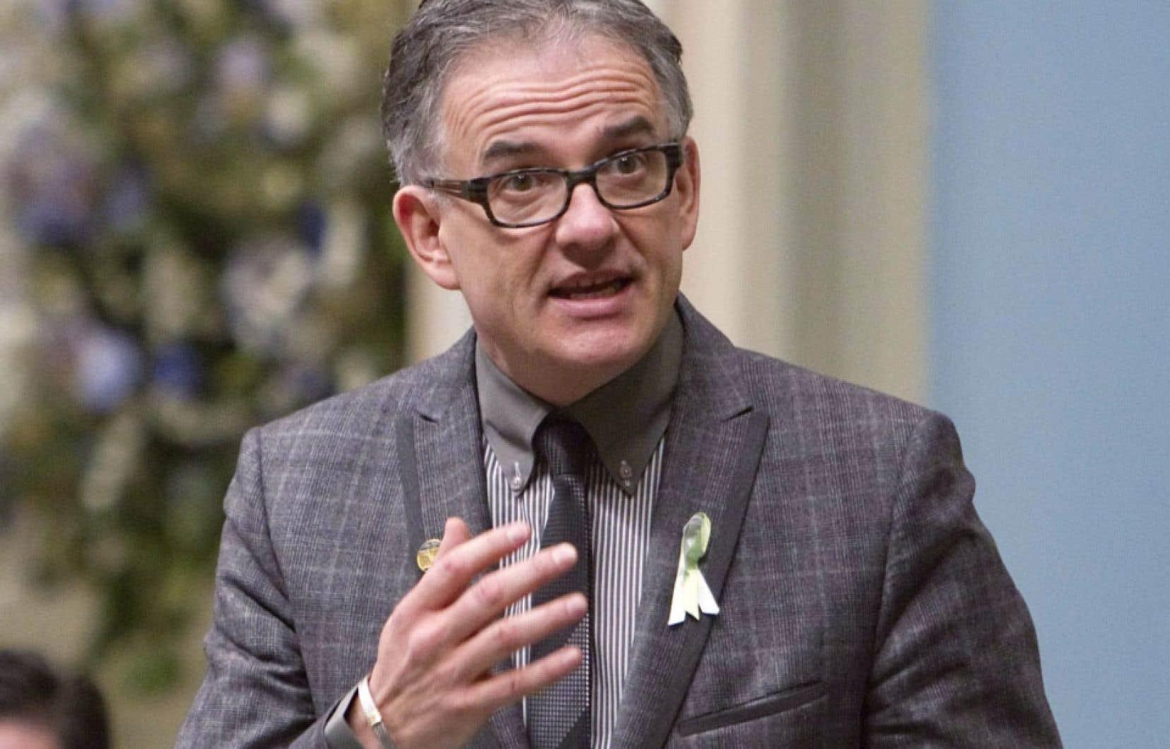 Le ministre de la Santé, Réjean Hébert
