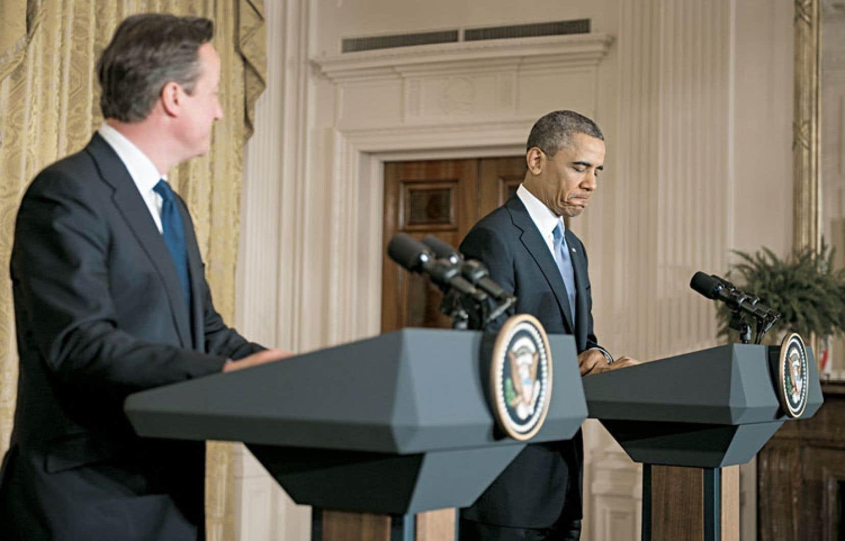 <div> Le premier ministre britannique, David Cameron, et le président américain, Barack Obama, au cours d'une conférence de presse commune à la Maison-Blanche.</div>