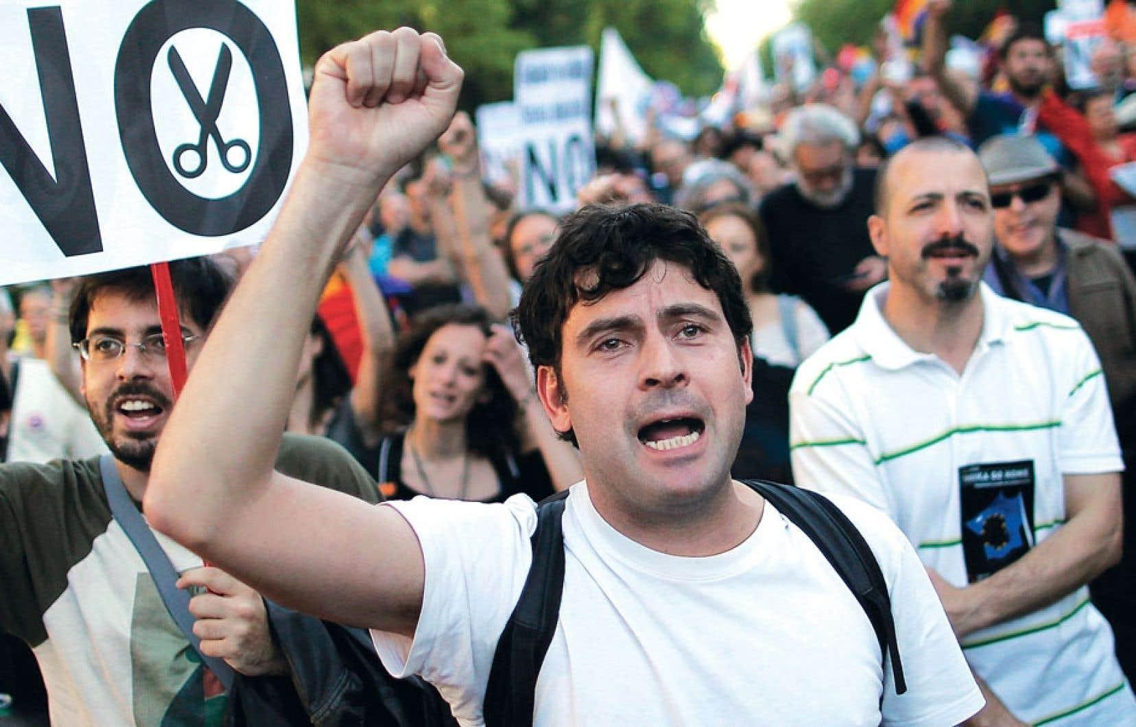 À Madrid, un manifestant en train de scander des slogans lors d'une autre manifestation anti-austérité tenue en même temps dans des dizaines de villes européennes samedi dernier.