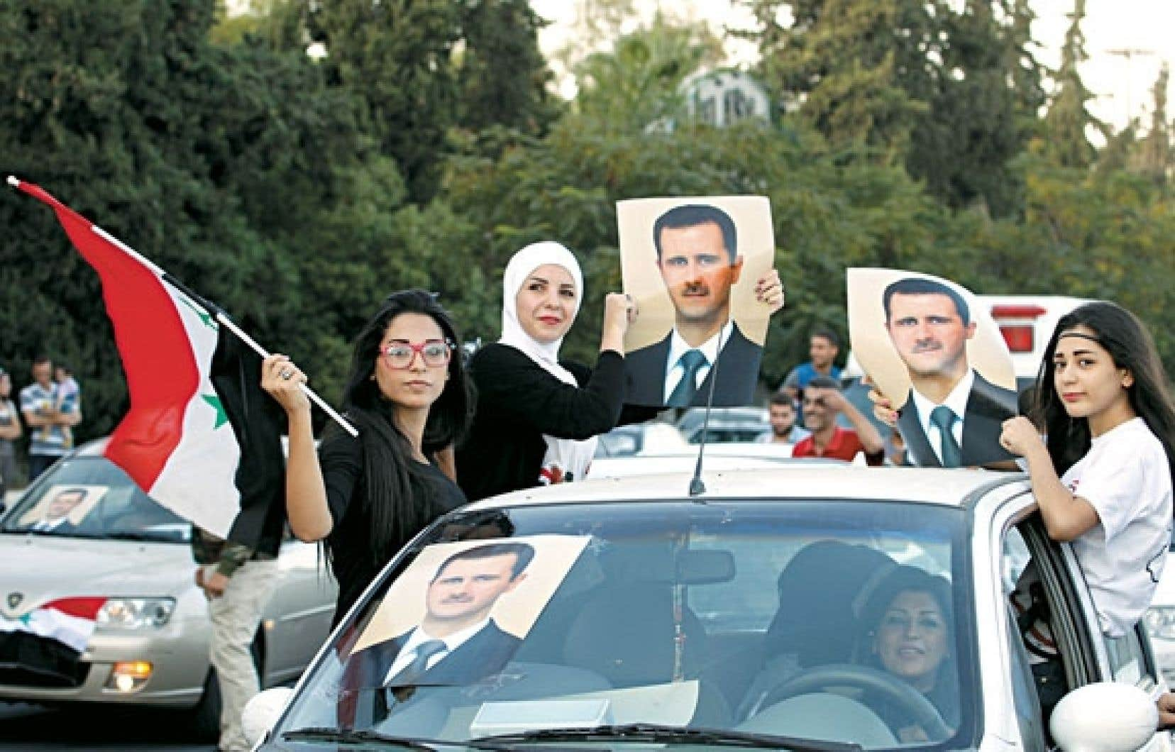 Des partisans de Bachar al-Assad ont célébré mercredi, à Damas, les 48 ans de leur président.
