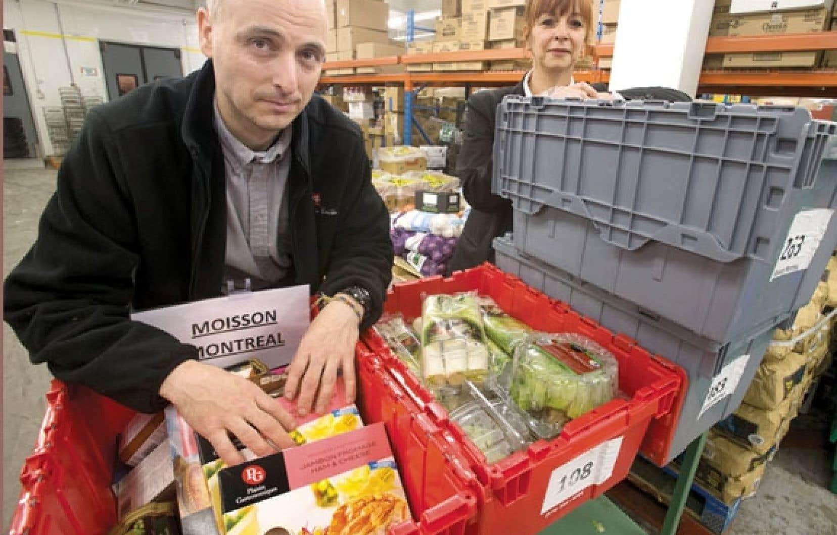 Comme employés de Provigo, Patrick Soultan et Carole Surprenant participent à la nouvelle collecte des produits de la viande, des denrées rarissimes pour les banques alimentaires.