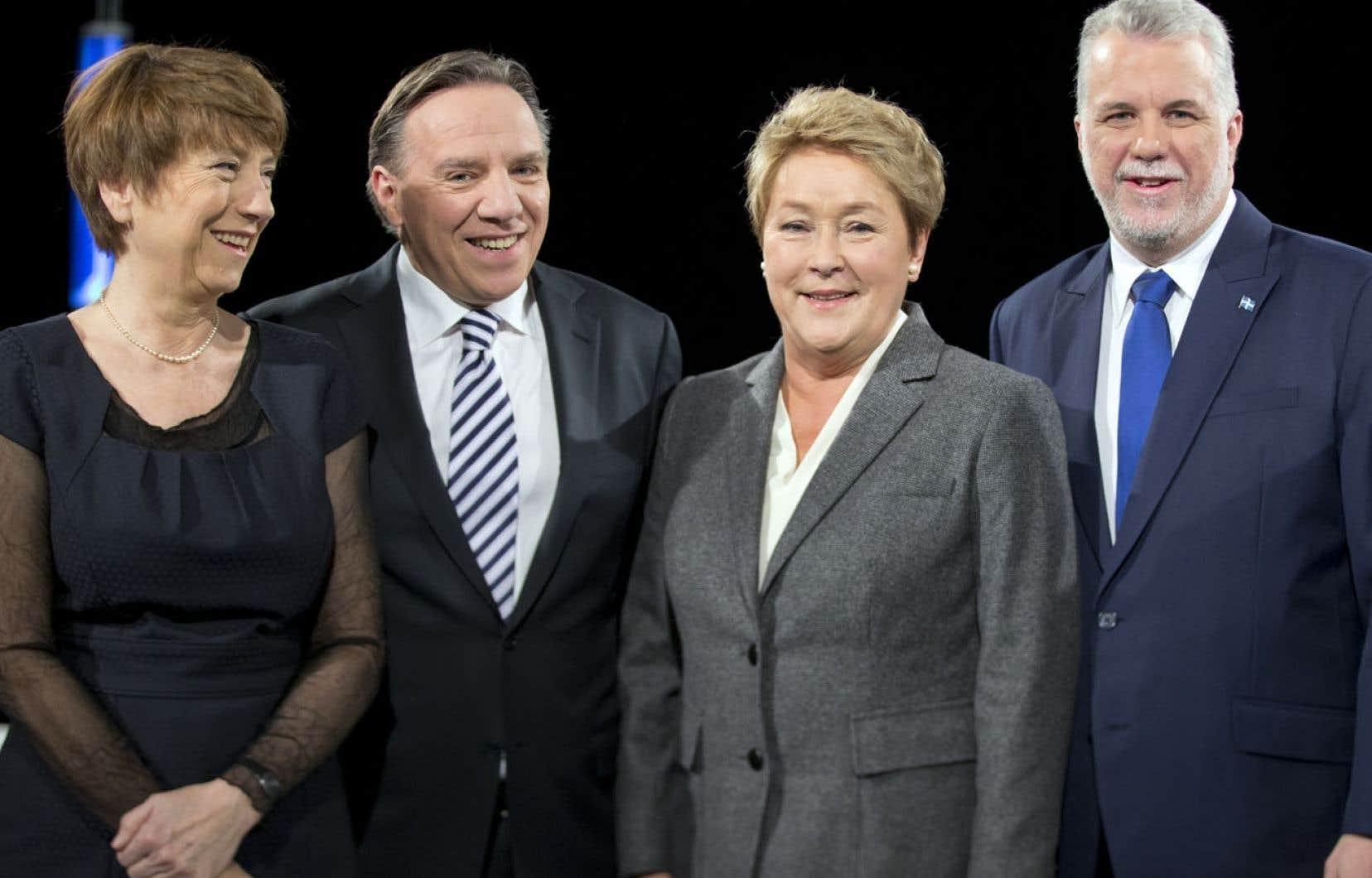 Françoise David, François Legault, Pauline Marois et Philippe Couillard s'affrontaient jeudi soir lors du premier débat télévisé de la campagne. Témoin d'une lutte serrée dans les sondages, le ton a souvent monté entre les chefs péquiste et libéral.