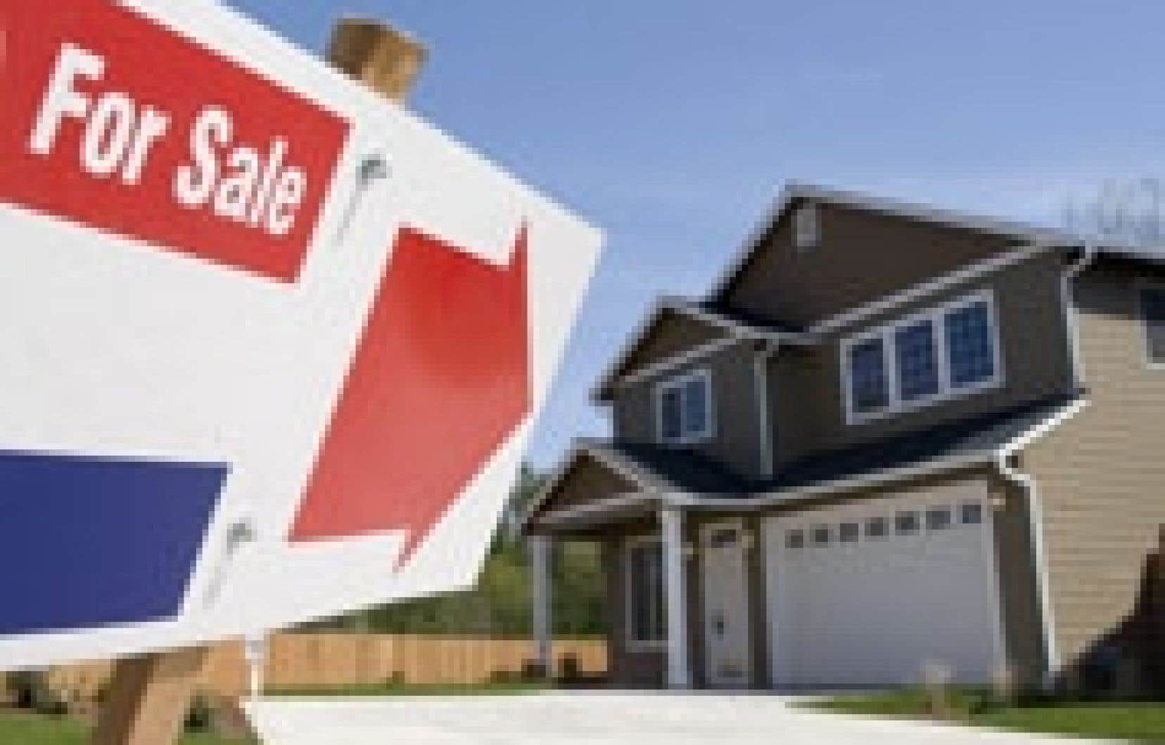 Une maison à vendre à Vancouver. Les augmentations du prix des maisons ont été particulièrement élevées dans l'Ouest.