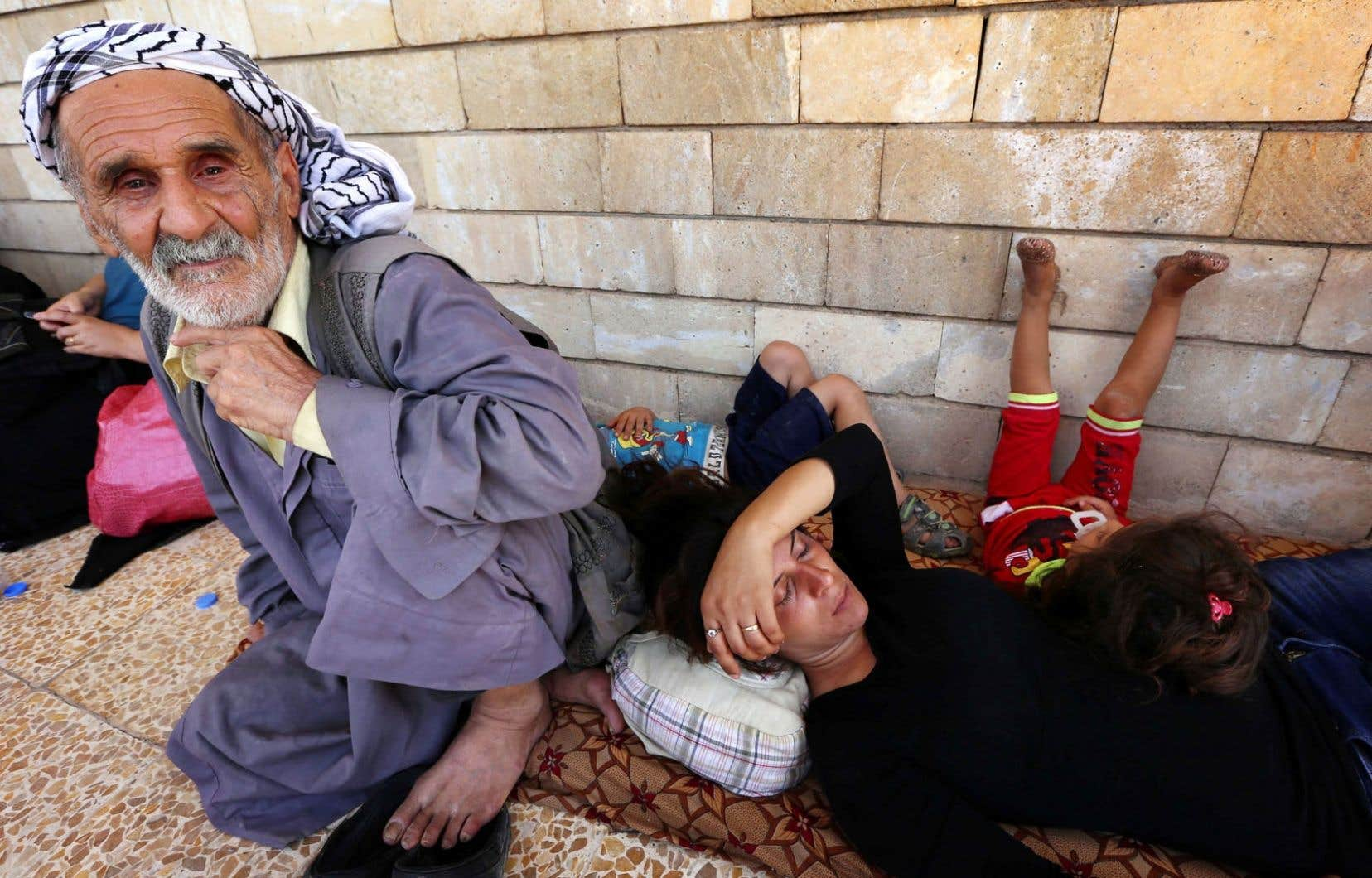 Des chrétiens d'Irak chassés de Qaraqosh par les attaques des djihadistes trouvent refuge à l'église Saint-Joseph d'Arbil, région autonome du Kurdistan.