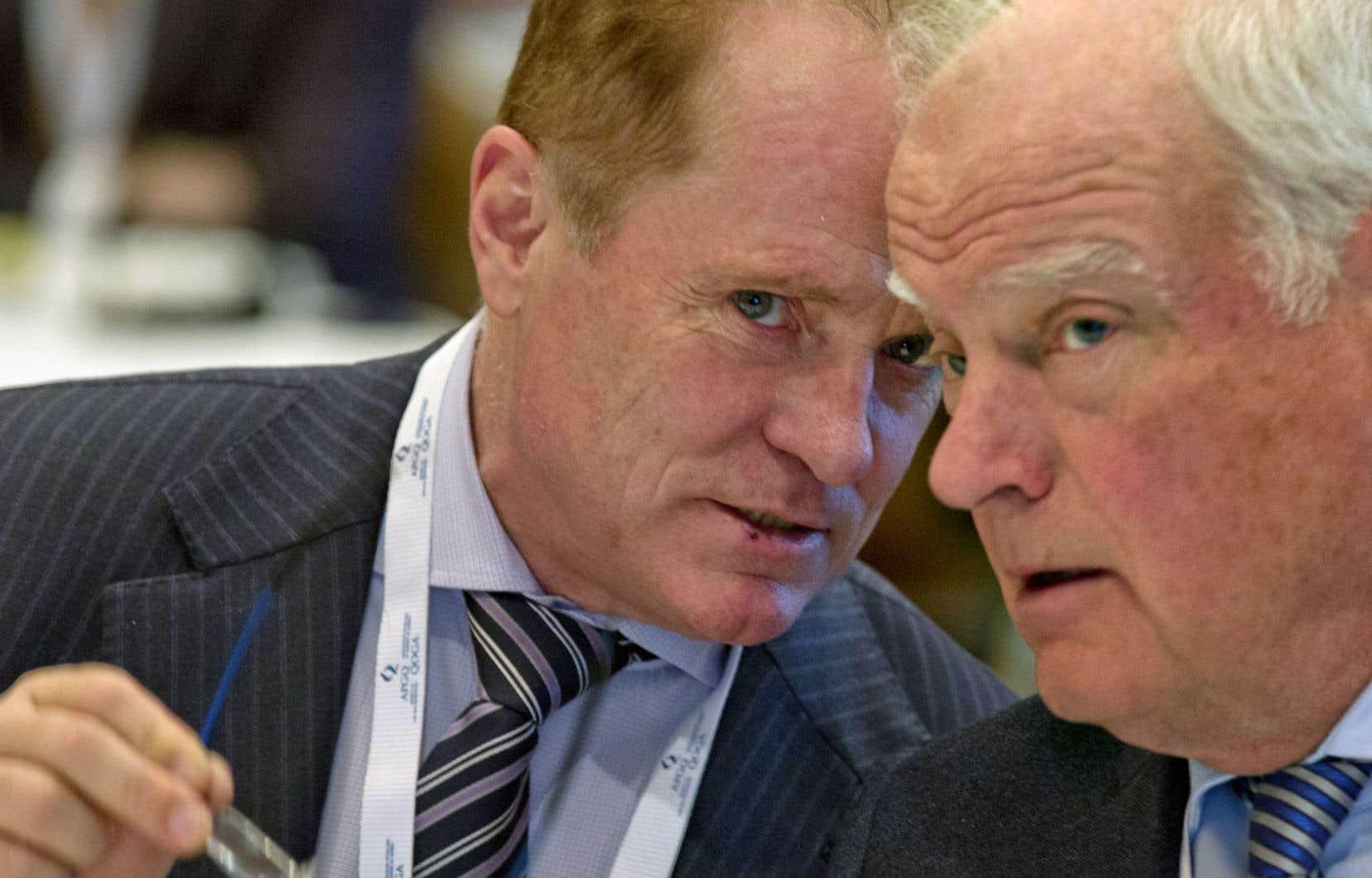 Michael Binnion, président de l'Association pétrolière et gazière du Québec, et André Caillé, administrateur de l'entreprise Junex.