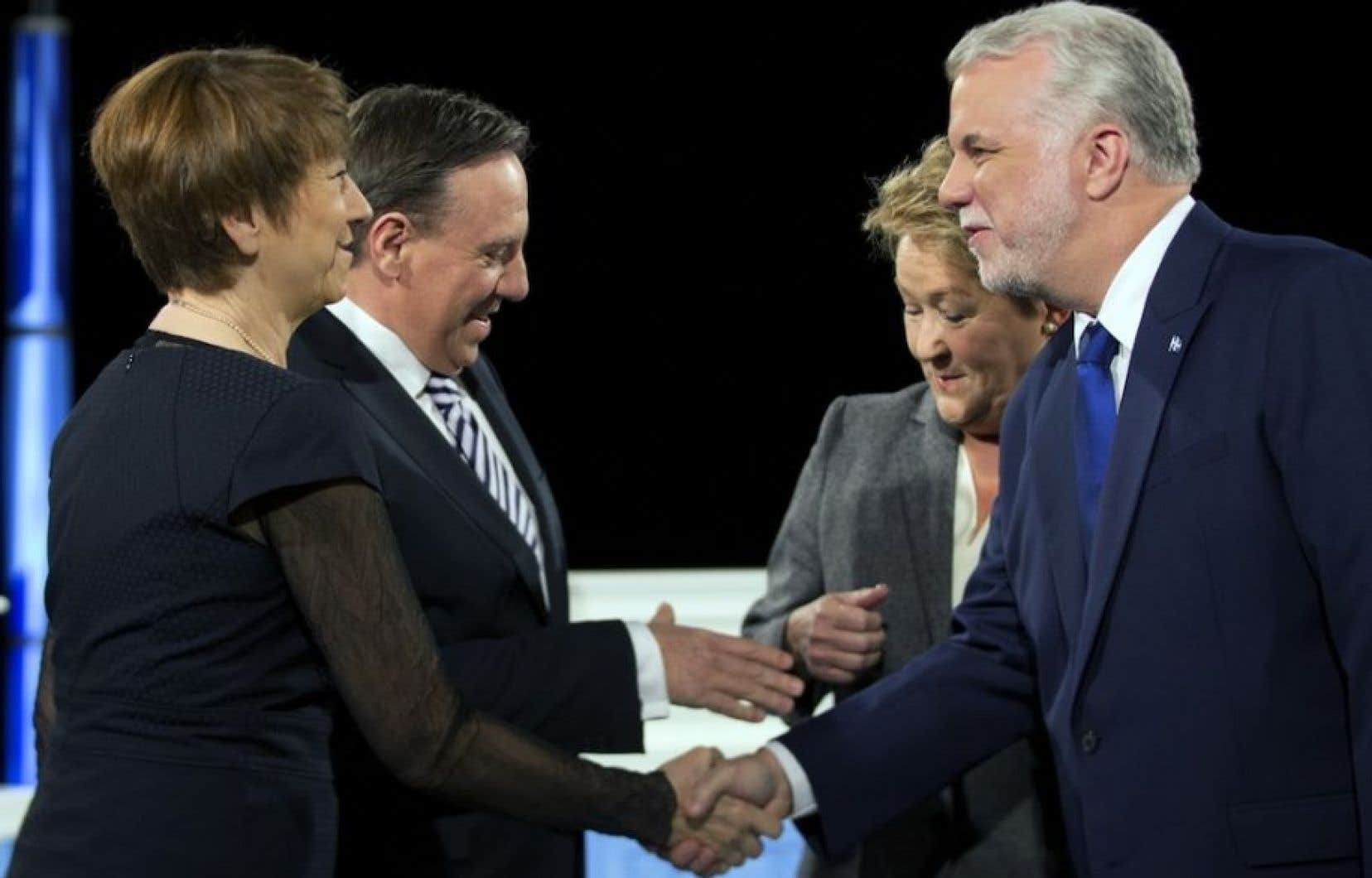 Les quatre candidats participant à un débat lors de la dernière campagne électorale québécoise.