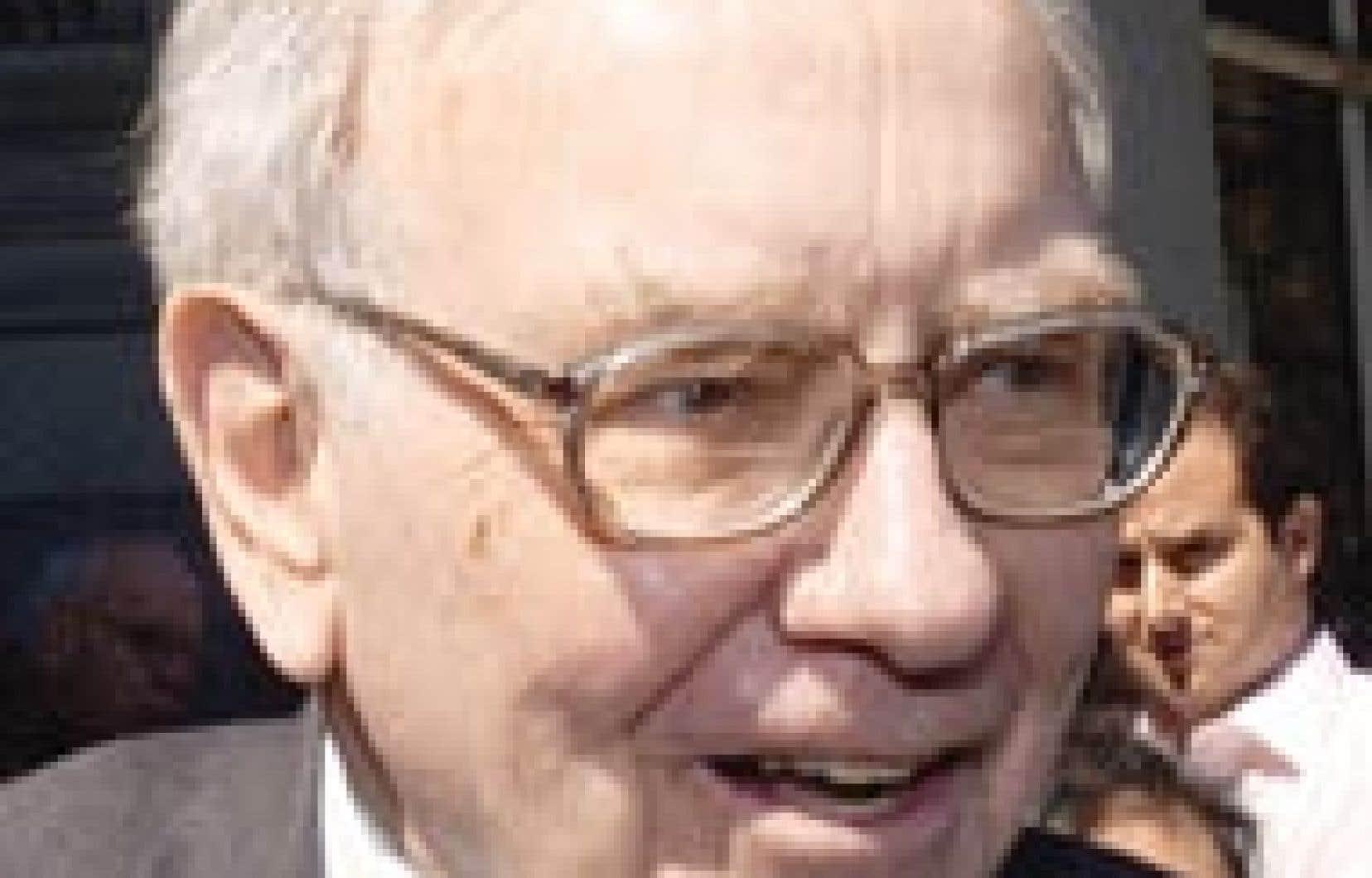 Warren Buffett à sa sortie des bureaux de la SEC, hier. «Je leur ai dit tout ce que je savais», a déclaré le milliardaire.
