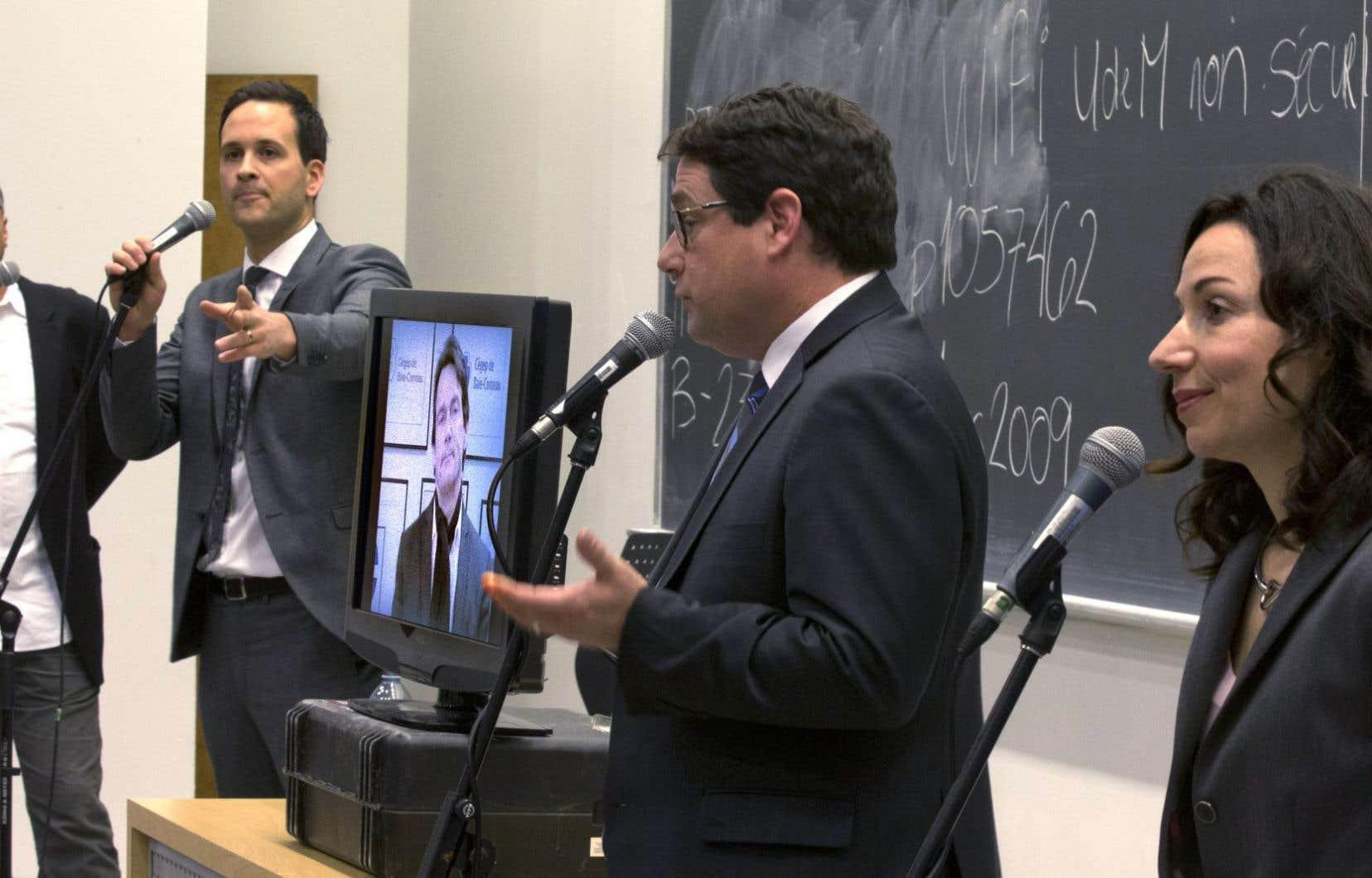 Pierre Céré, Alexandre Cloutier, Pierre Karl Péladeau, Bernard Drainville et Martine Ouellet avaient rendez-vous mercredi dans une salle de classe de l'Université de Montréal.