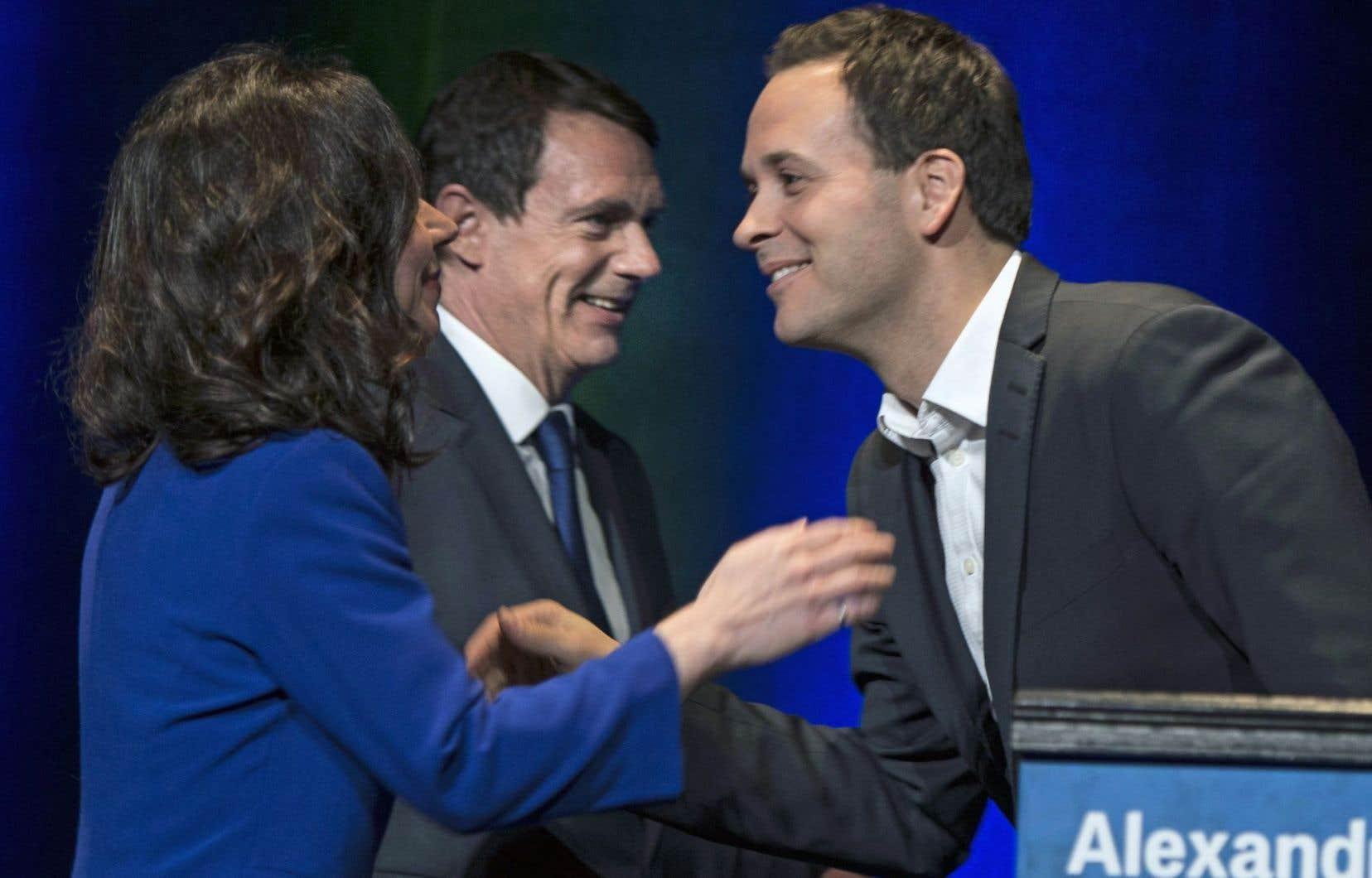 Trois des candidats à la chefferie du PQ, Martine Ouellet, Pierre Karl Péladeau et Alexandre Cloutier