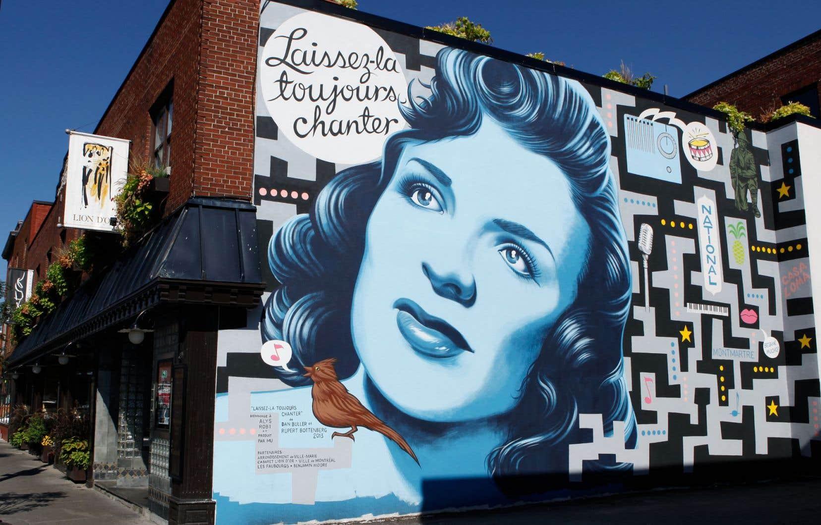 Une murale de Dan Buller et Rupert Bottenberg représentant Alys Robi, rue Ontario à Montréal.<br /> <br />
