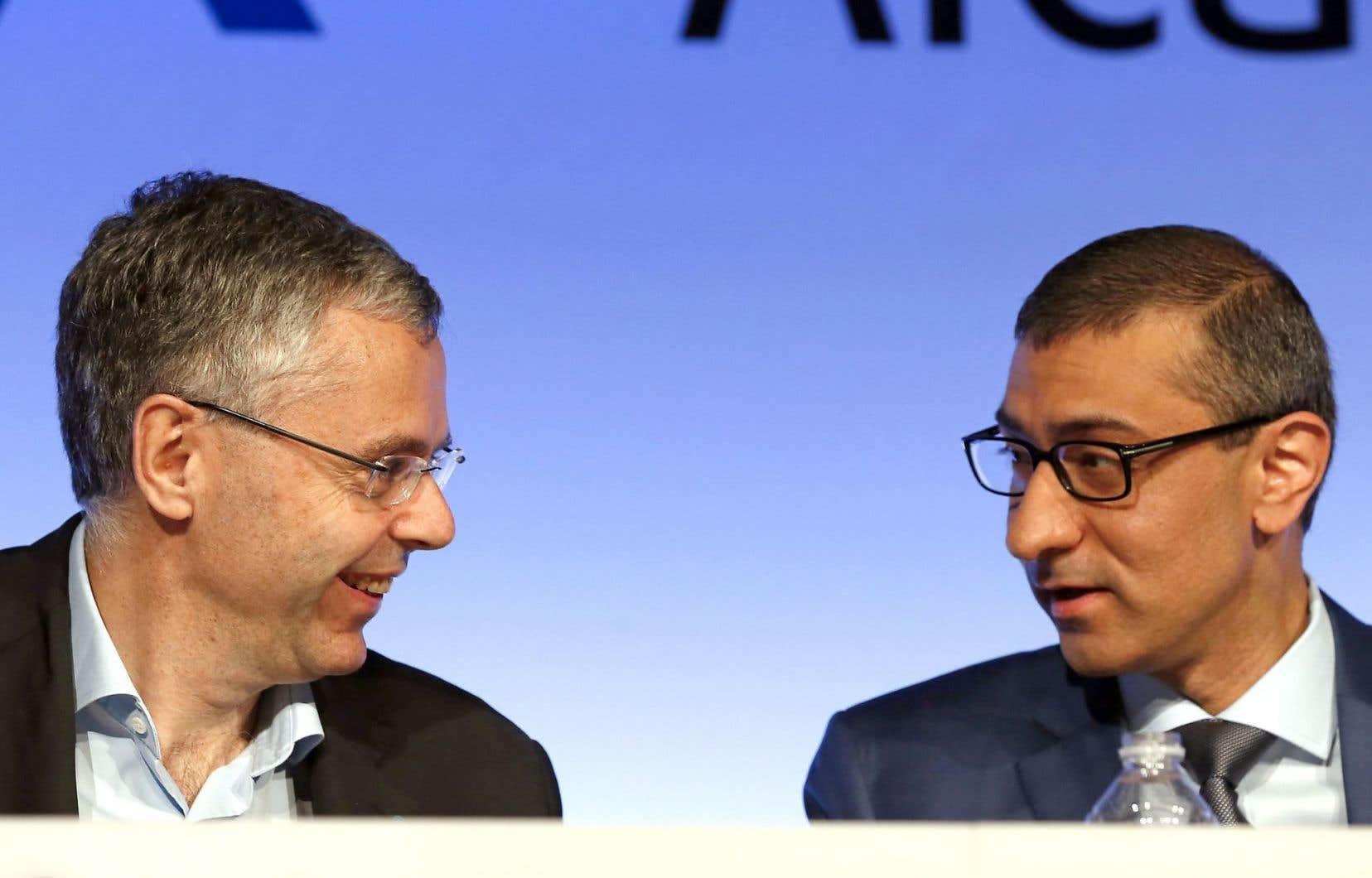 Le chef de la direction d'Alcatel-Lucent, Michel Combes, et celui de Nokia, Rajeev Suri, lors de la conférence de presse.