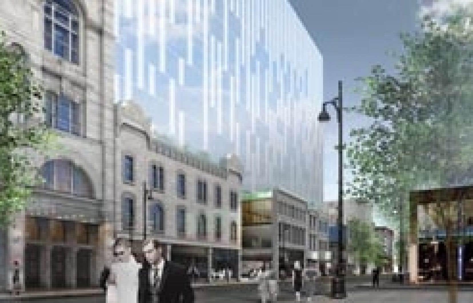 La proposition architecturale vise la reconstruction de toutes les façades du boulevard, l'installation de commerces à vocation «responsable», l'ajout d'un passage liant Saint-Laurent et la rue Clark et la construction d'un gratte-ciel de ver