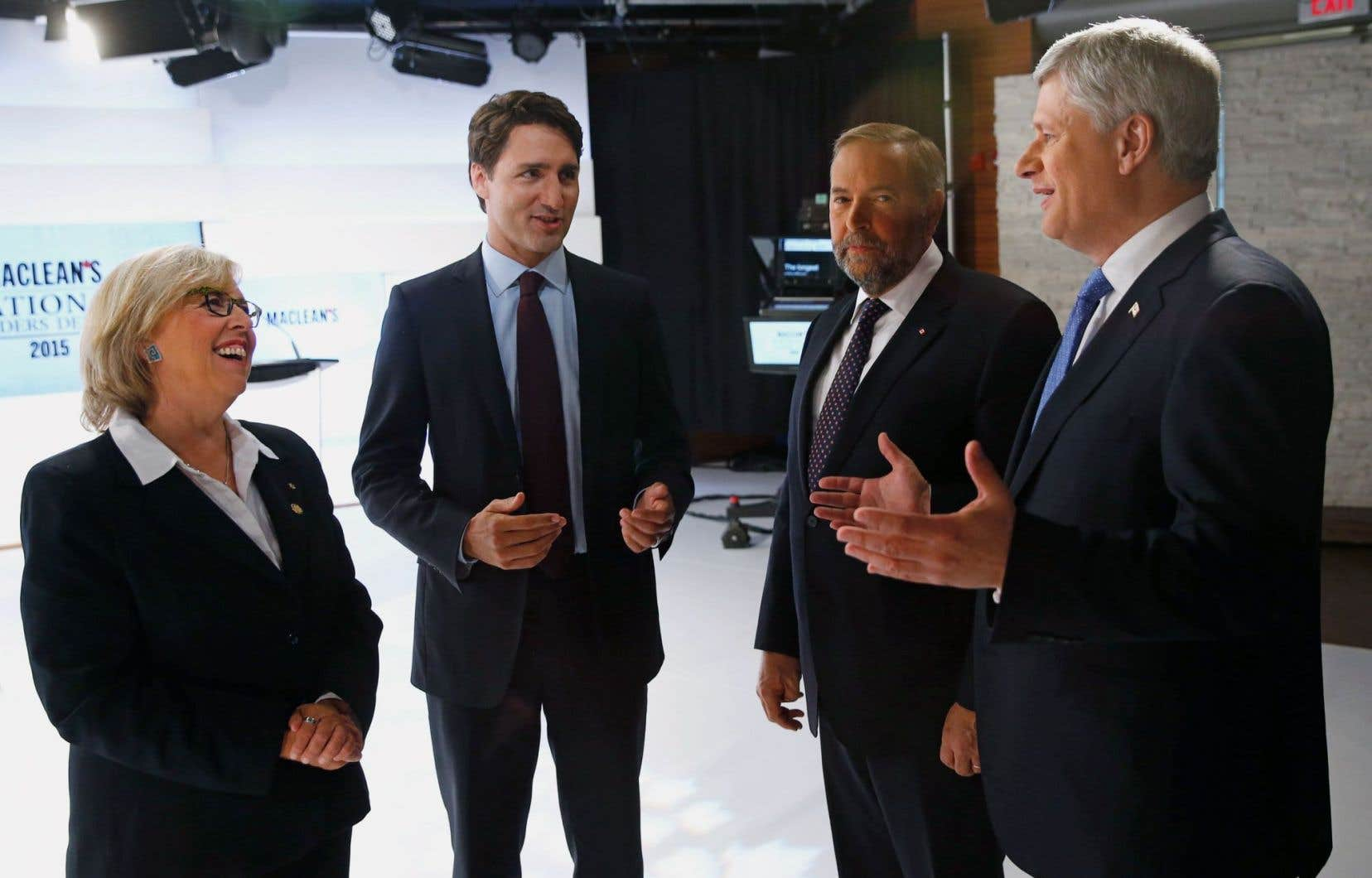 Élizabeth May du Parti vert du Canada, Justin Trudeau des libéraux, le néodémocrate Thomas Mulcair et Stephen Harper du Parti conservateur du Canada lors du débat des chefs organisé par «Maclean's» le 6 août