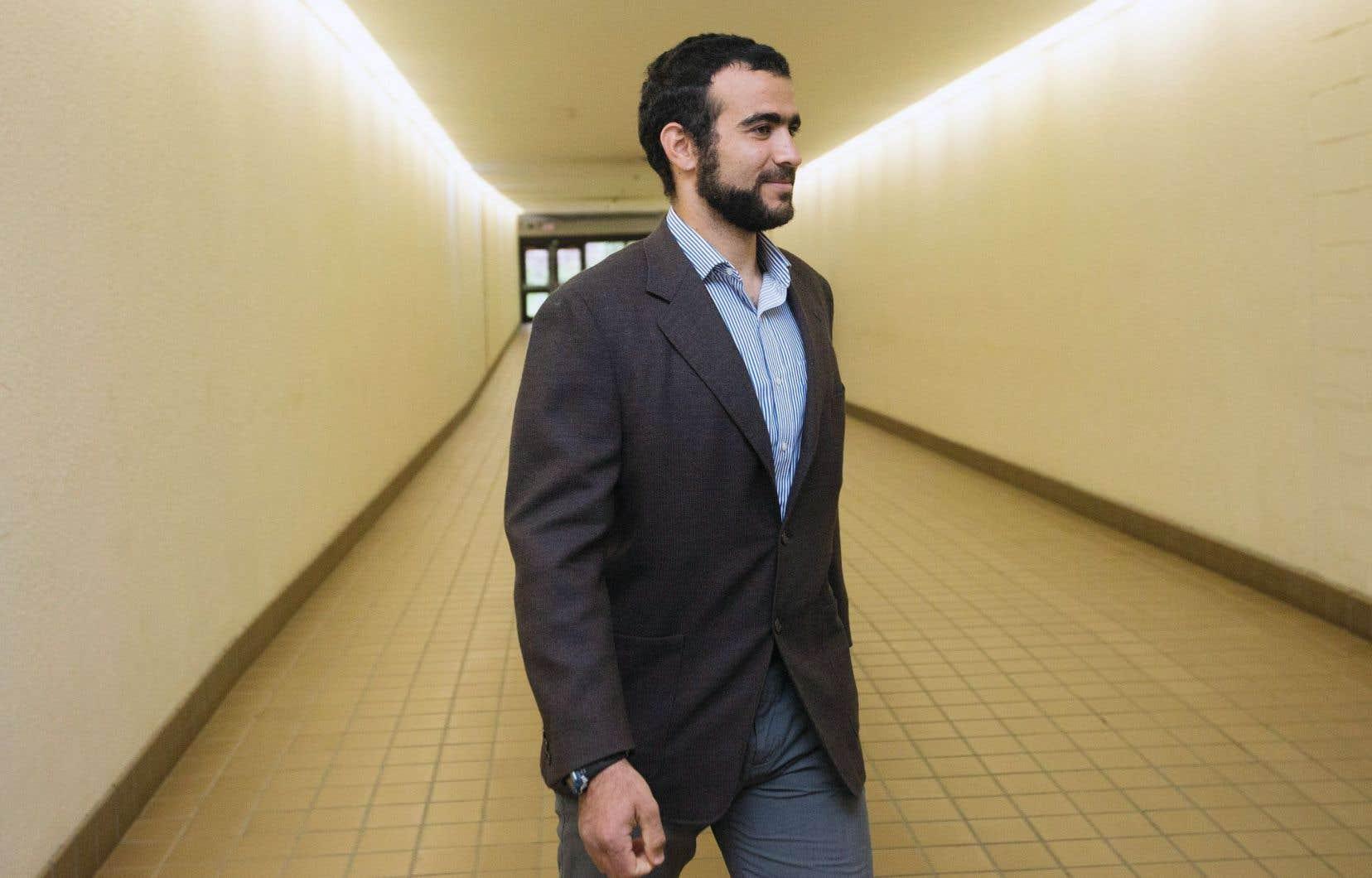« Je suis content », a déclaré Omar Khadr en quittant la salle d'audience vendredi, à Edmonton.
