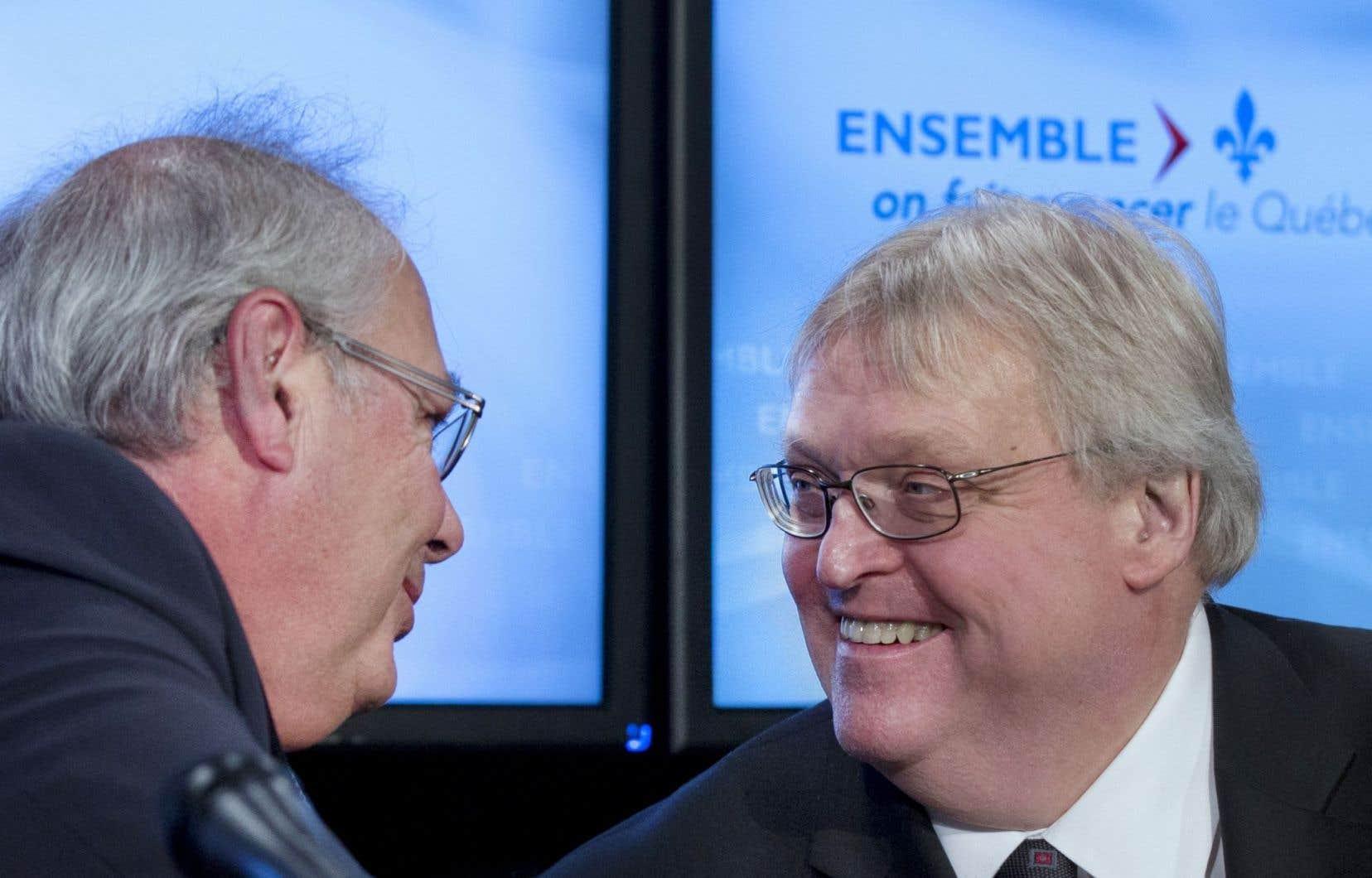 Le président de la Fédération des médecins omnipraticiens du Québec, Louis Godin, et le ministre de la Santé, Gaétan Barrette