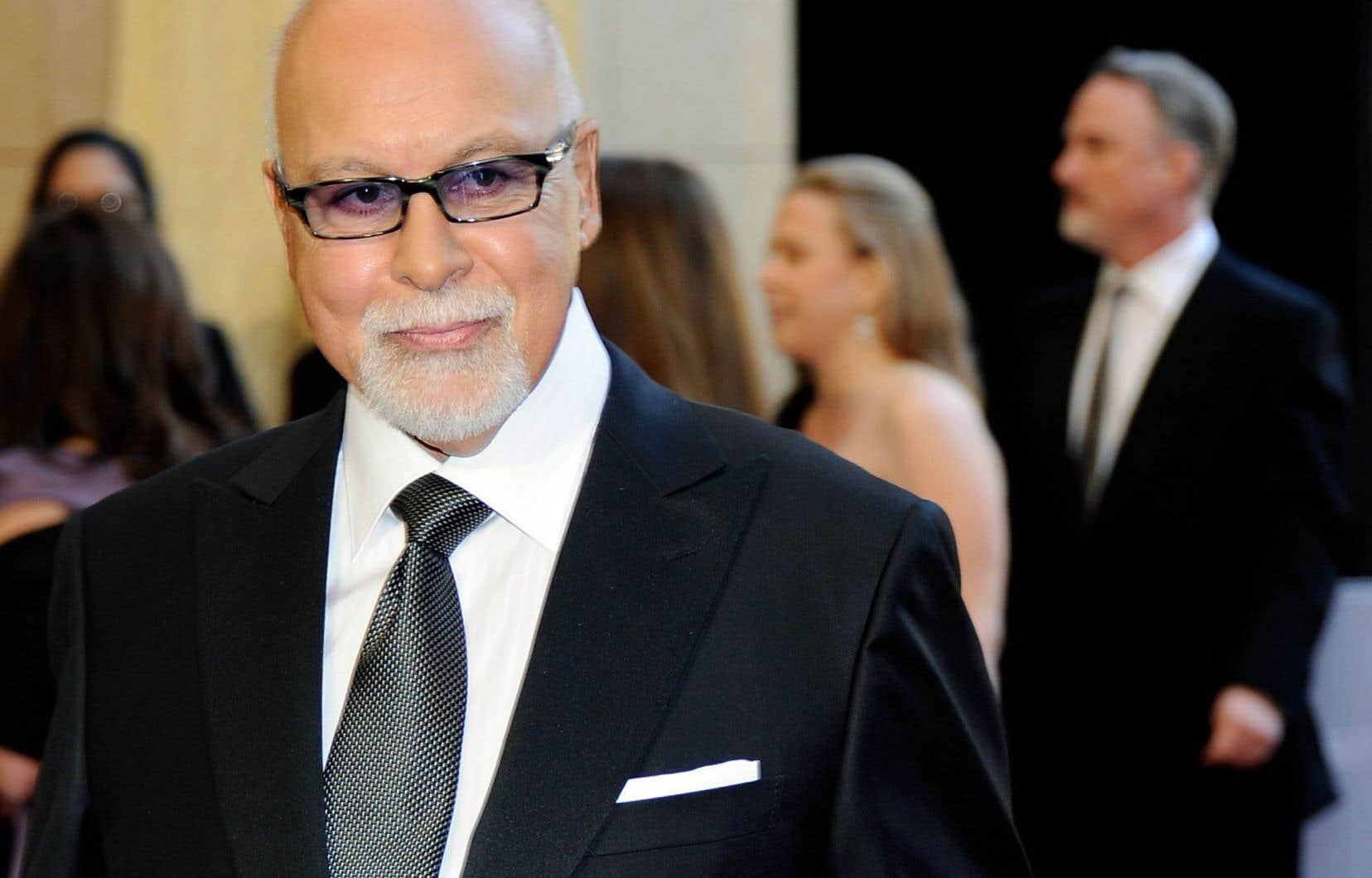 René Angélil à son arrivée à la cérémonie des Oscar en février 2011. Selon l'animatrice Monique Giroux, «non seulement René Angélil a mis la carrière de Céline sur les rails, mais il a mis la chanson québécoise sur les rails».