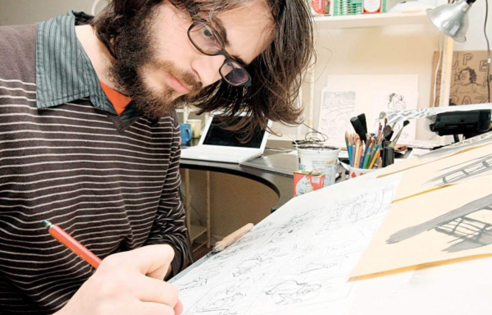 Le bédéiste Vincent Giard à sa table de travail