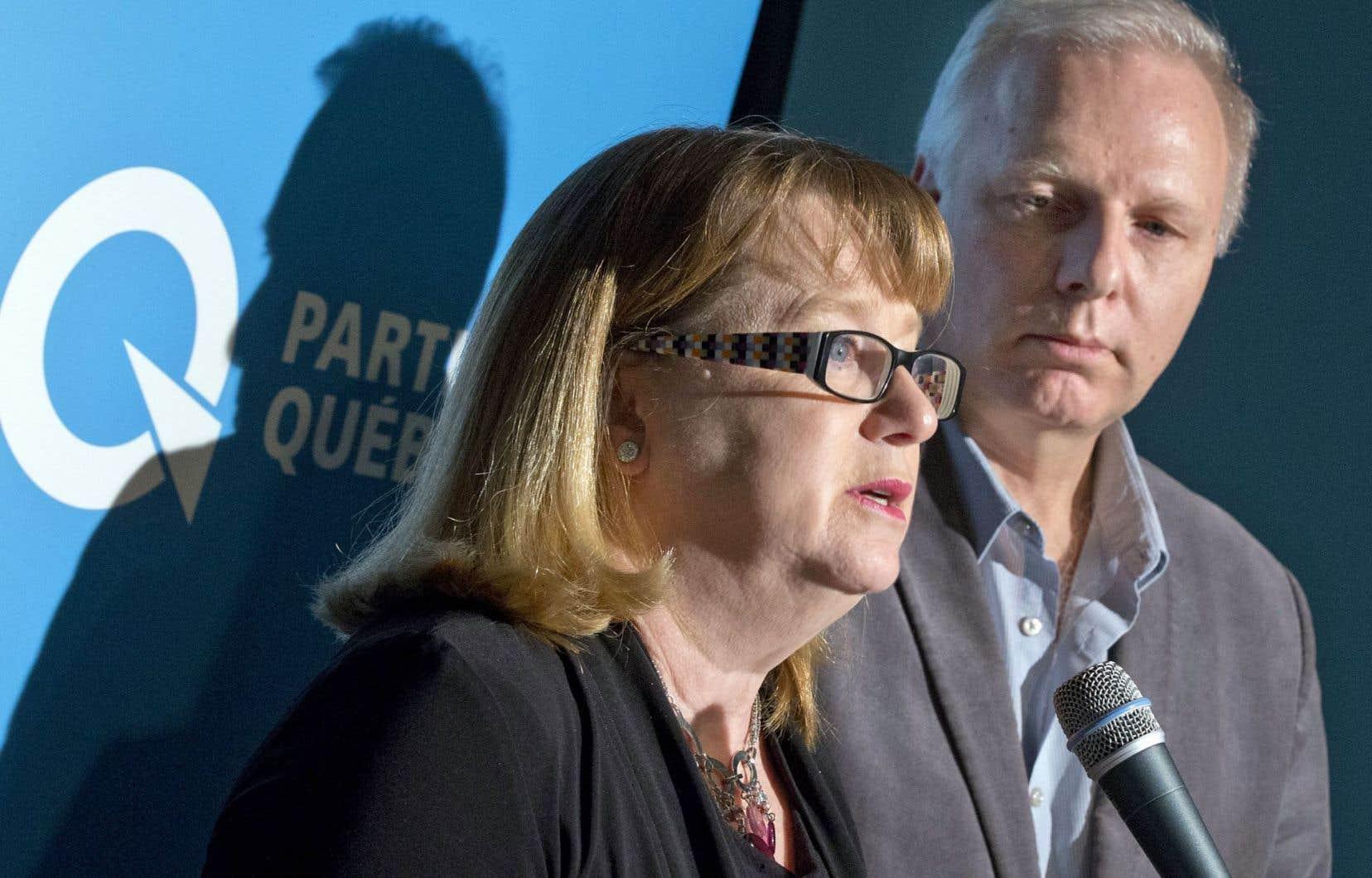 Les porte-parole péquistes en matière de condition féminine et de protection de la jeunesse, Carole Poirier et Jean-François Lisée