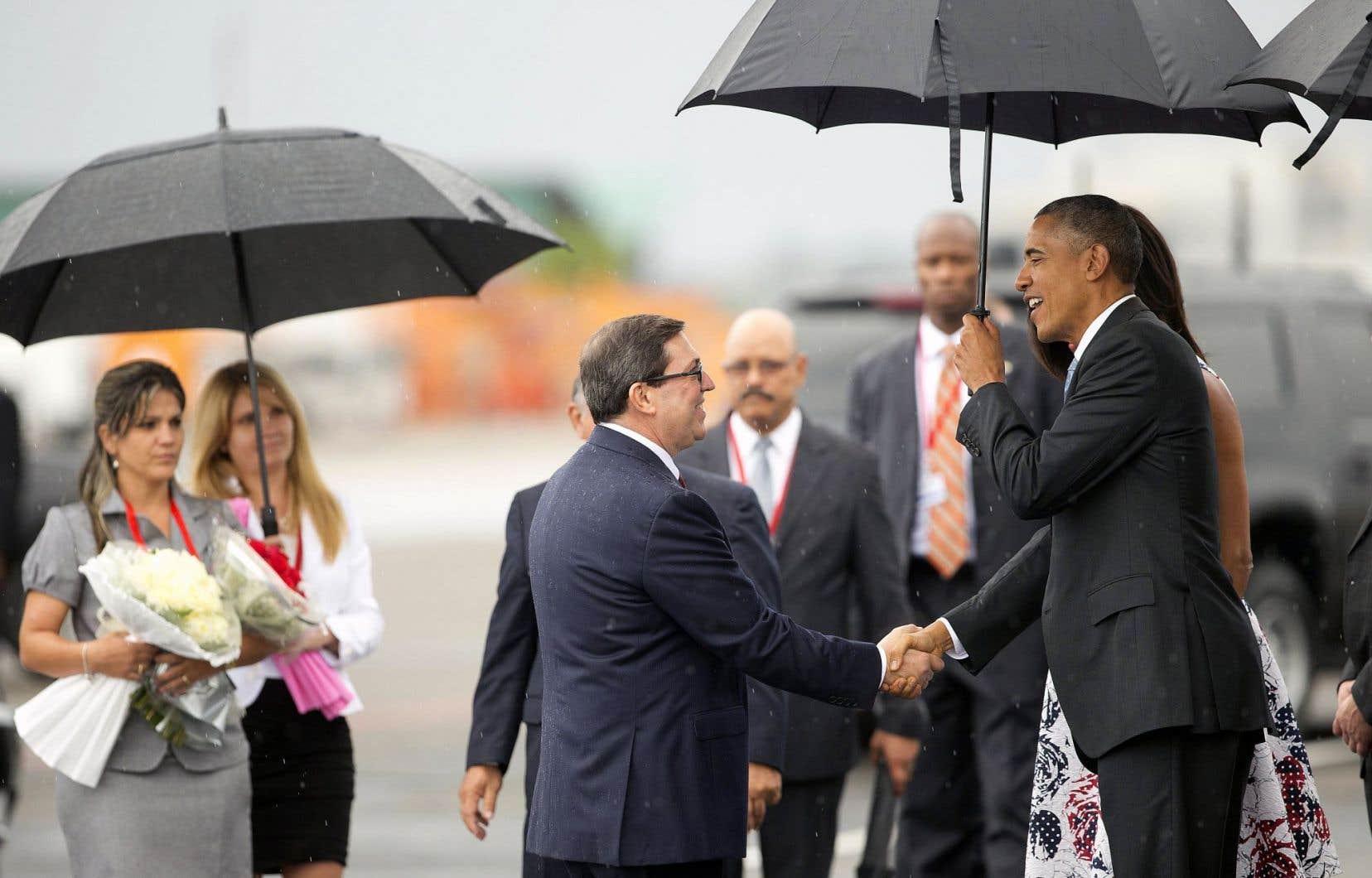 Dès son arrivée à La Havane, le président des États-Unis, Barack Obama, et son épouse, Michelle Obama, ont été accueillis par le ministre des Affaires étrangères cubain, Bruno Rodriguez.