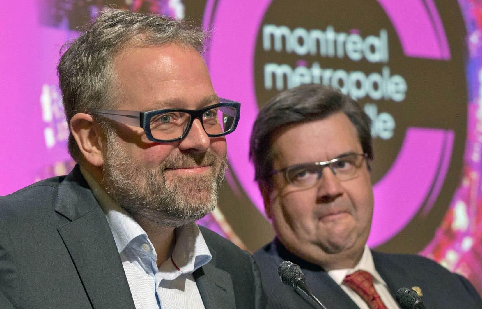Alexandre Taillefer, qui présidait le comité de pilotage du plan d'action, avec le maire Denis Coderre.