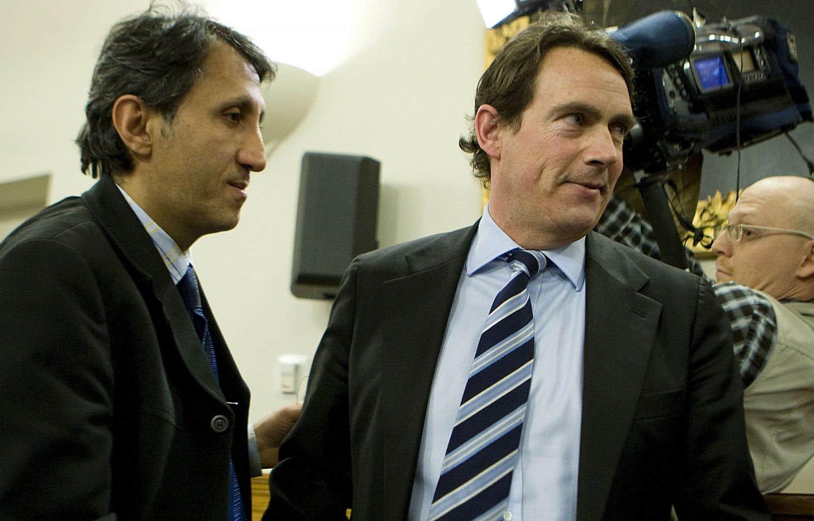 En tant que chef du PQ, Pierre Karl Péladeau (à droite) aura notamment tendu la main à Québec solidaire et à l'un de ses députés, Amir Khadir.
