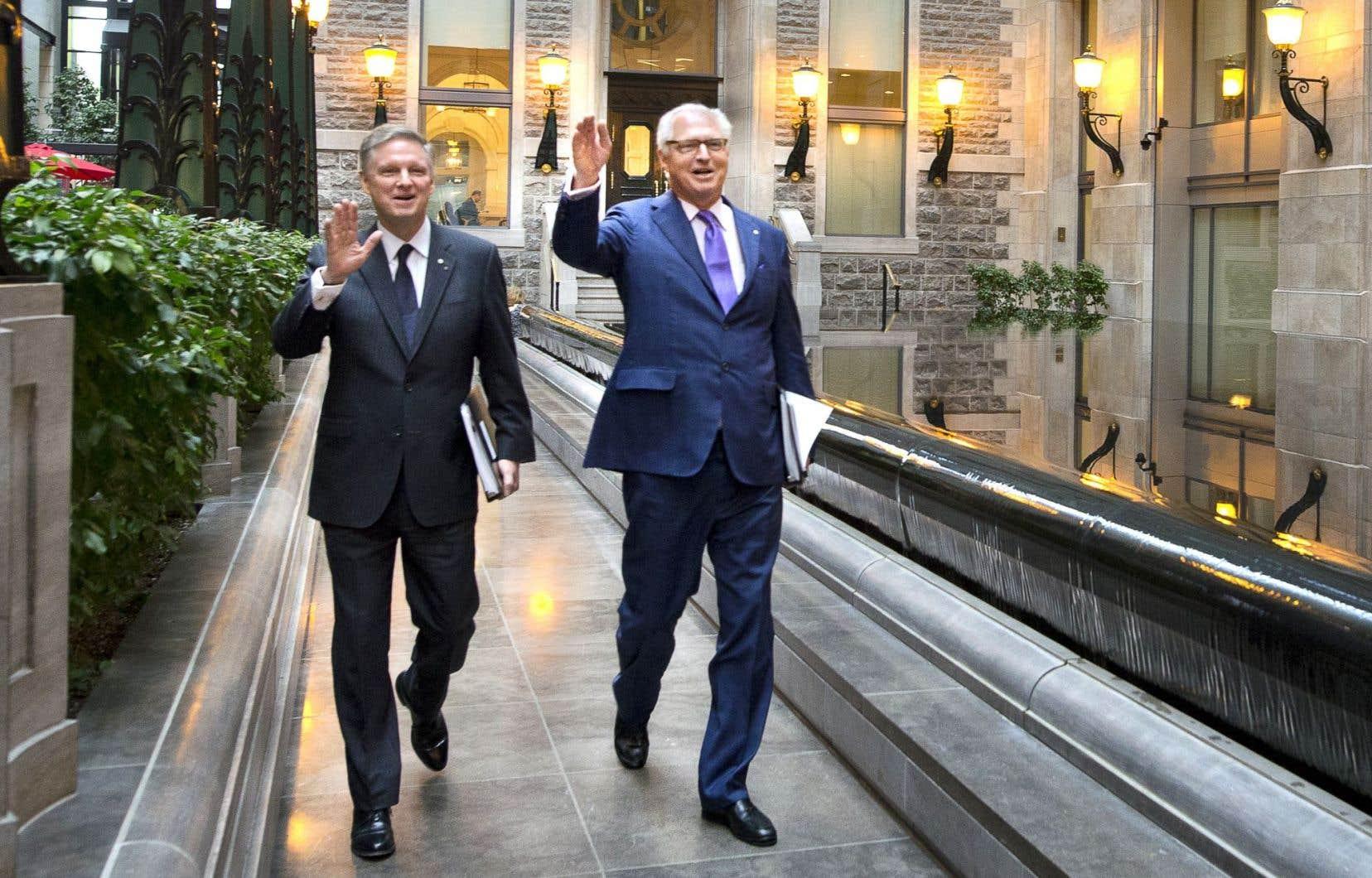 Les frères Paul et André Desmarais photographiés alors qu'ils se rendaient à l'assemblée des actionnaires de Power Corporation.