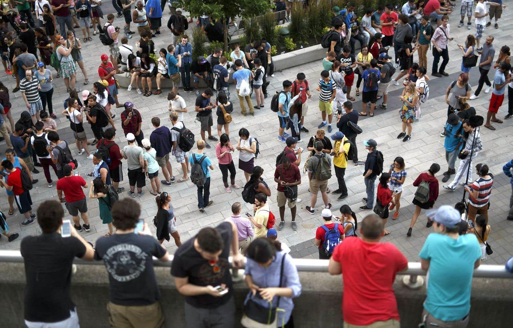 L'engouement pour Pokémon Go se vérifie partout où le jeu est disponible, comme on le voit sur cette photo prise à Toronto.