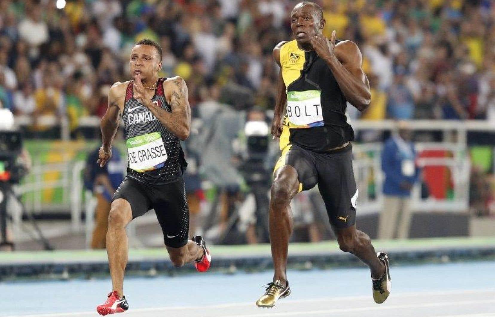 Le Jamaïcain Usain Bolt (droite)et le Canadien Andre De Grasse