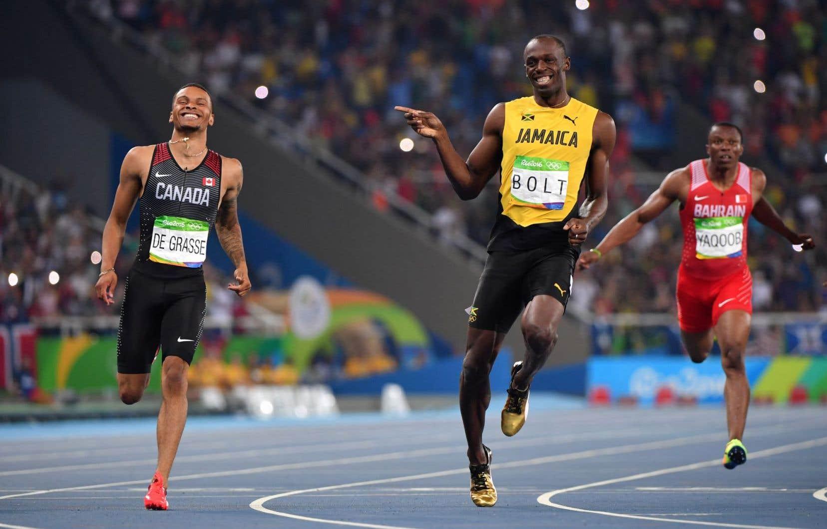 Andre De Grasse et Usain Bolt se sont échangé des plaisanteries pendant la course.