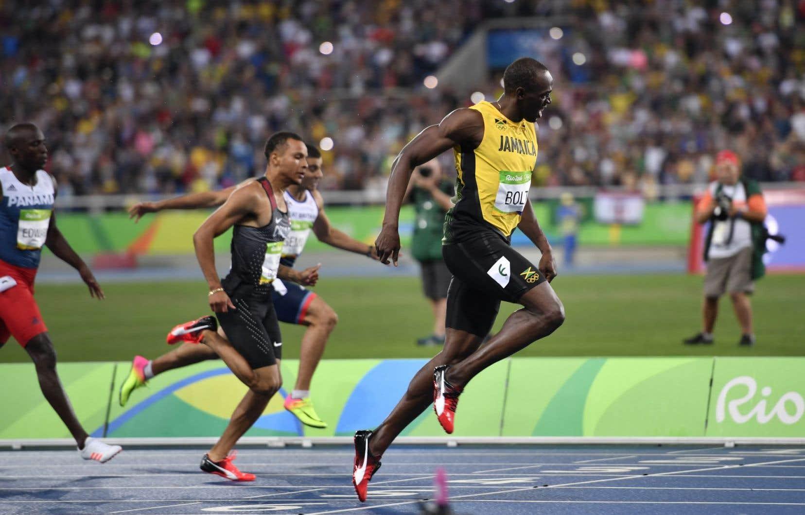 Andre De Grasse (à gauche) et Usain Bolt (à droite)