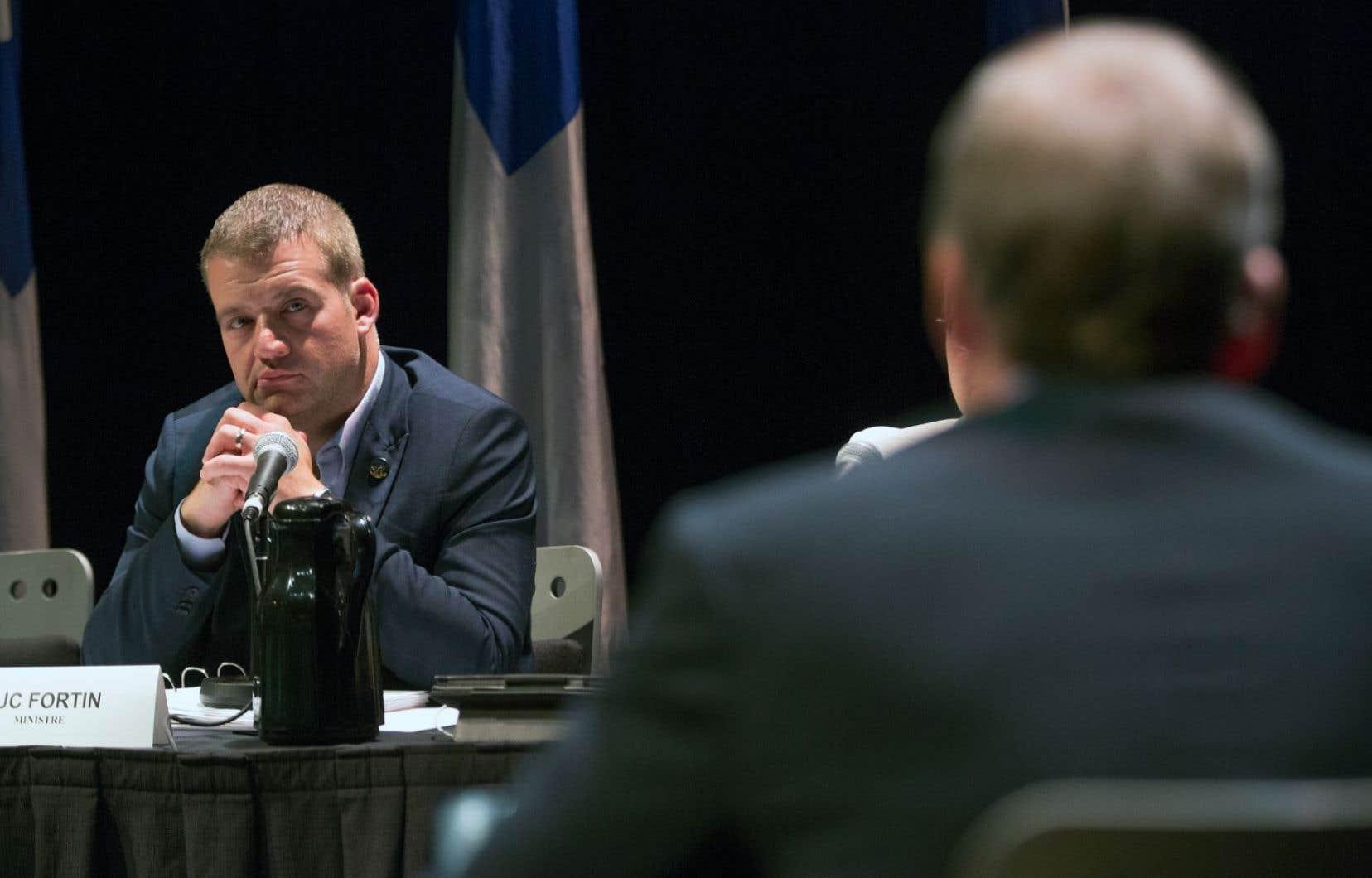Le ministre Luc Fortin a demandé à Brian Myles comment il envisageait de préserver l'impartialité des médias si ceux-ci recevaient du financement de l'État.