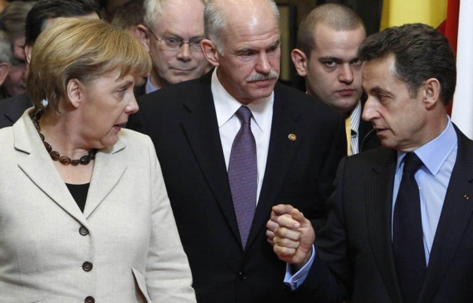 Angela Merkel et Nicolas Sarkozy après le sommet européen informel de jeudi.