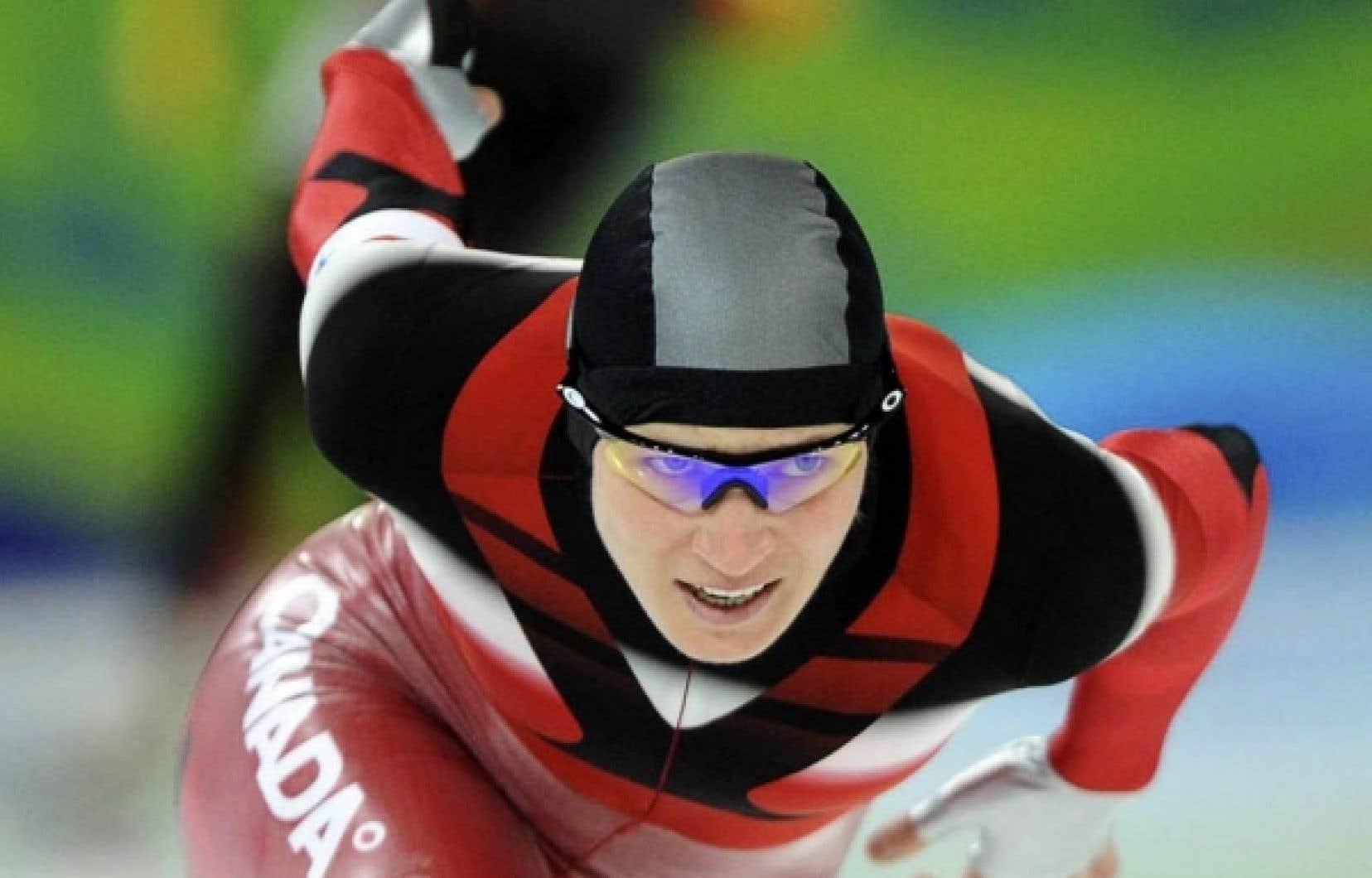 Les experts s'attendaient à deux médailles canadiennes au 1500 m, hier, mais seule Kristina Groves est montée sur le podium en remportant l'argent à l'Anneau olympique de Richmond.