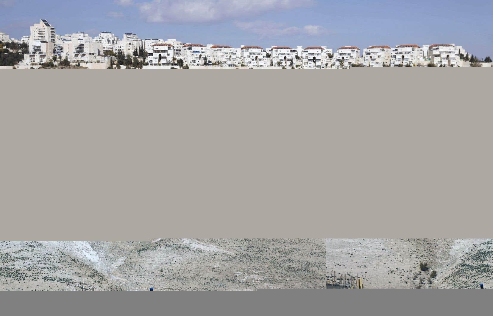 Des travailleurs palestiniens s'affairaient sur le chantier d'un projet immobilier dans une colonie israélienne, dimanche. La mairie israélienne de Jérusalem prévoit construire des centaines d'autres logements dans des quartiers de colonisation.