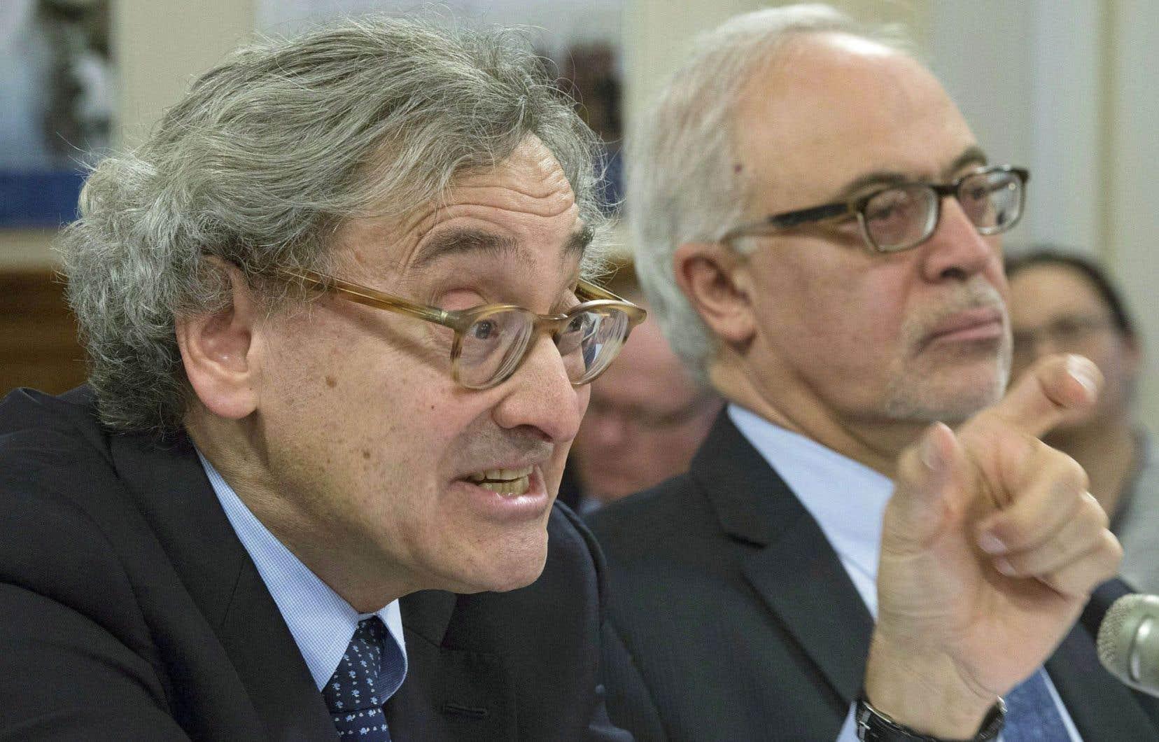Michael Sabia, président de la Caisse de dépôt et placement du Québec, et, en arrière-plan, le ministre des Finances du Québec, Carlos Leitão