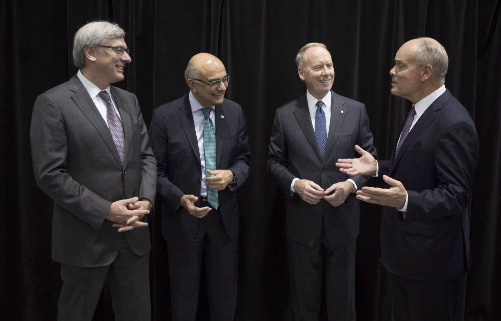 De gauche à droite, le président et chef de la direction de la Banque Royale, David McKay (gauche), en compagnie de ses homologues Bharat Masrani (TD), Bill Downe (BMO) et Brian Porter (Banque Scotia), le 9 mars 2017.