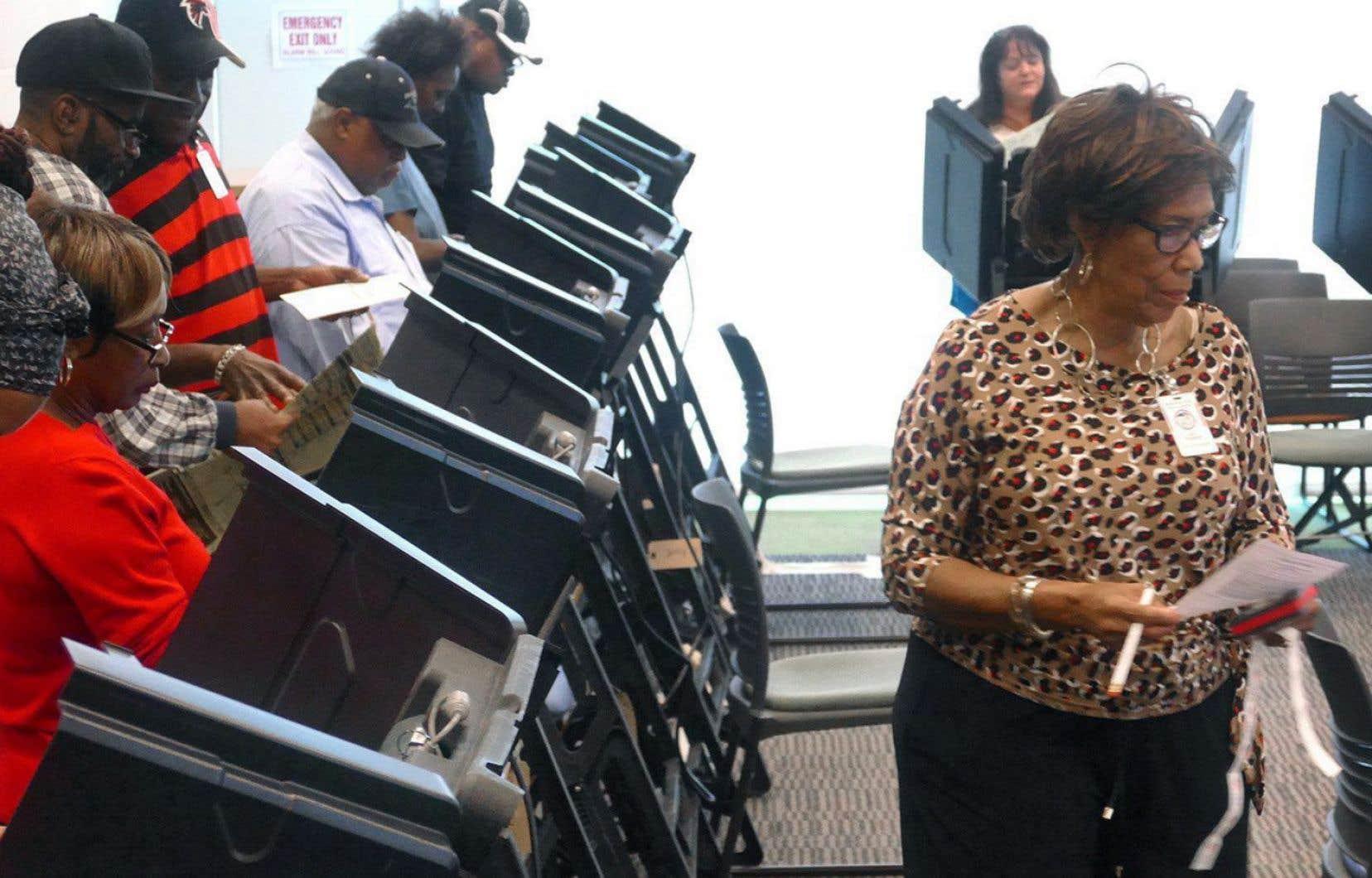 Des électeurs ayant voté par anticipation, le 20 octobre dernier, à Charlotte, en Caroline du Nord