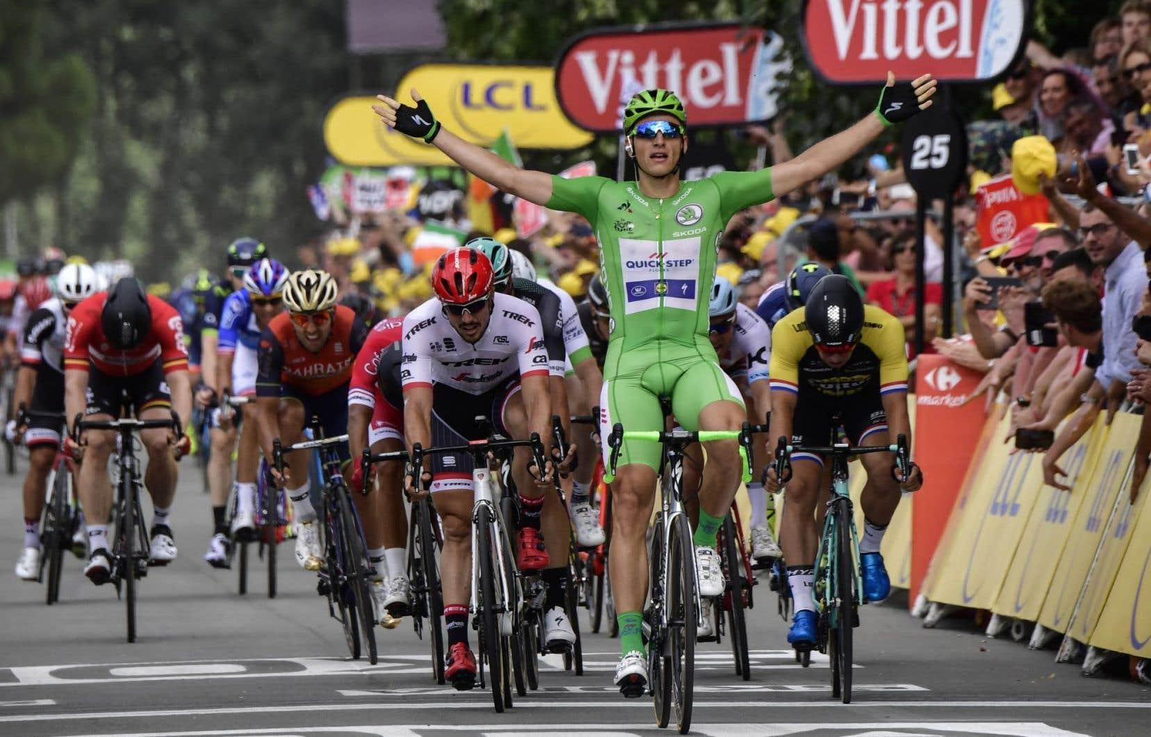Kittel (en vert ci-dessus) a porté à 13 son total de victoires d'étape dans le Tour, le plus élevé pour un coureur allemand toutes générations confondues.