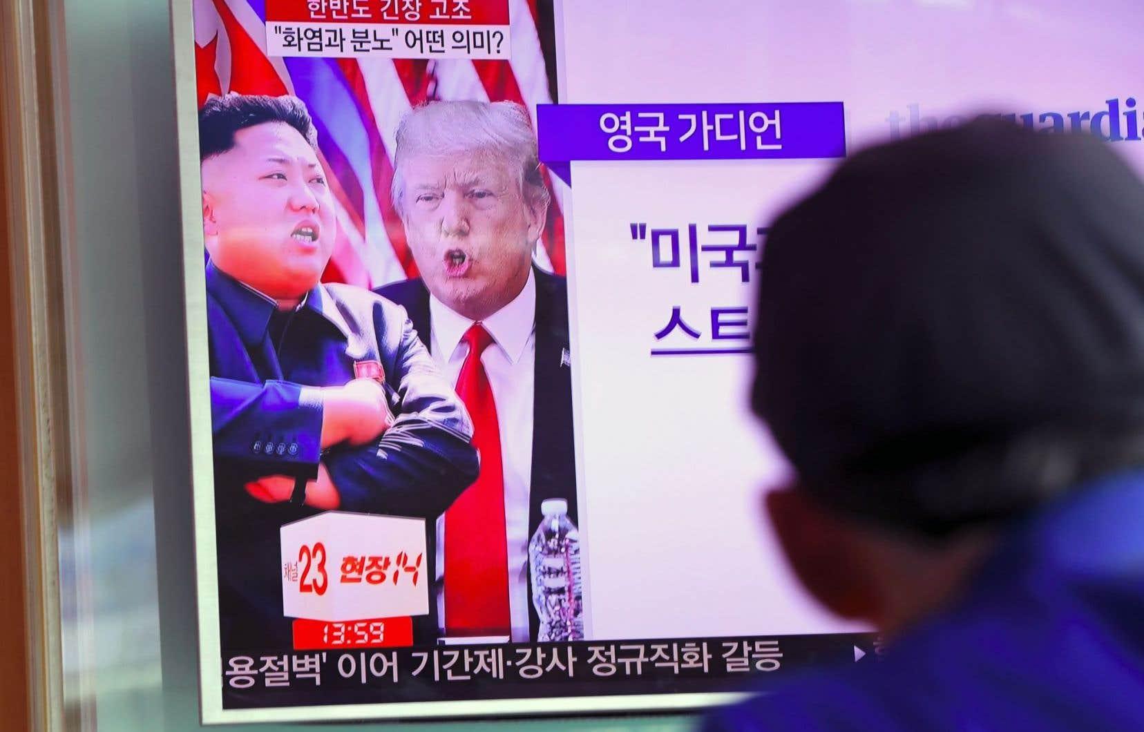 Kim Jong-un et Donald Trump apparaissent sur un téléviseur dans une gare de la capitale de la Corée du Sud, Séoul, mercredi.