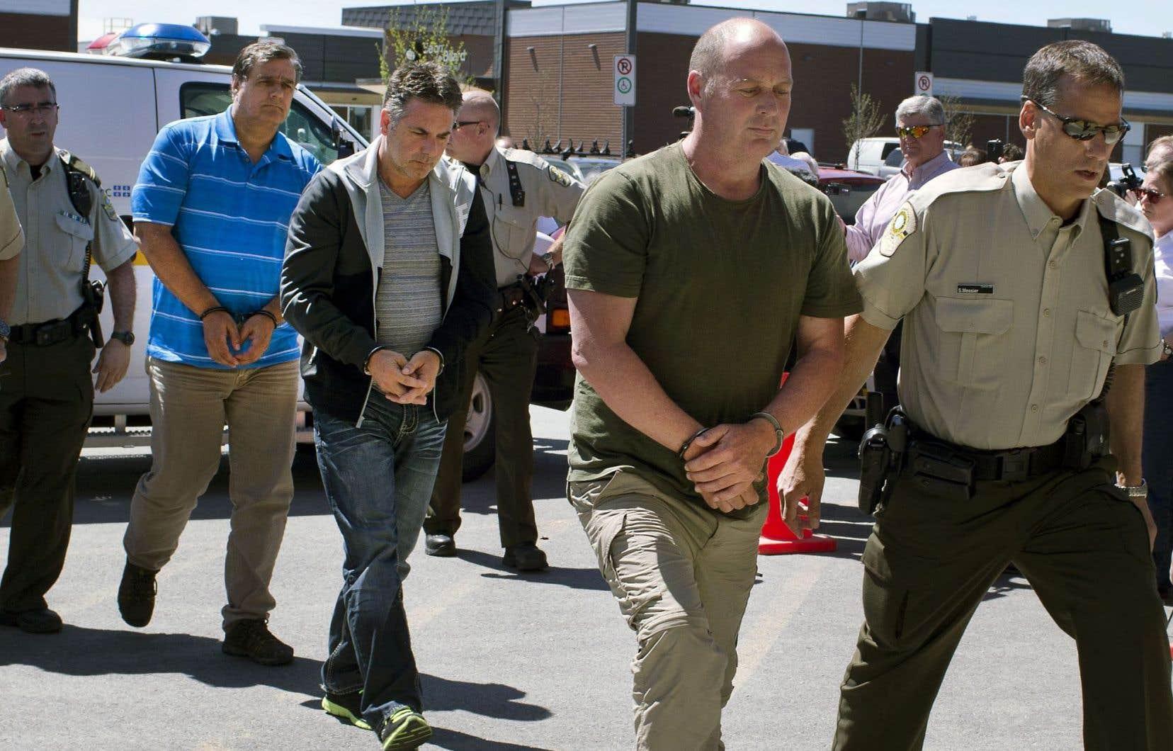 Les trois accusés en 2014: Richard Labrie (à gauche), Jean Demaître (au centre) et Thomas Harding.