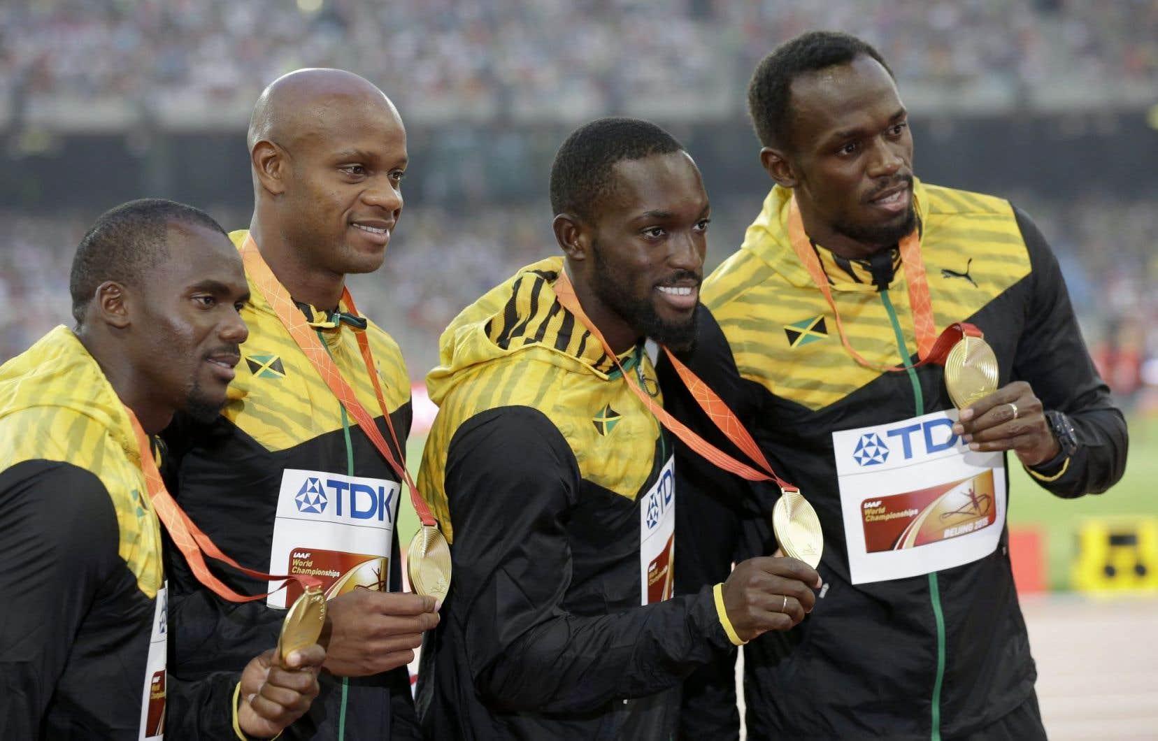 L'équipe jamaïquainedu relais 4 x 100 mètres, qui a remporté la course avec un chrono record de 37,10 secondes. À gauche, Nesta Carter.