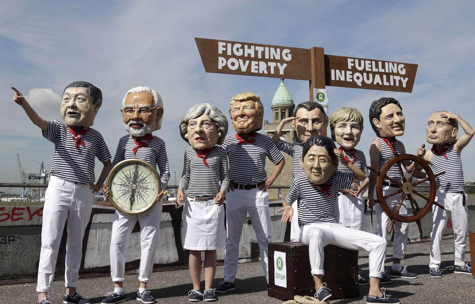 Des manifestants de l'organisme Oxfam portaient des têtes à l'effigie de chefs d'État pour protester contre les inégalités et la pauvreté au sommet du G20 à Hambourg, en juillet dernier.