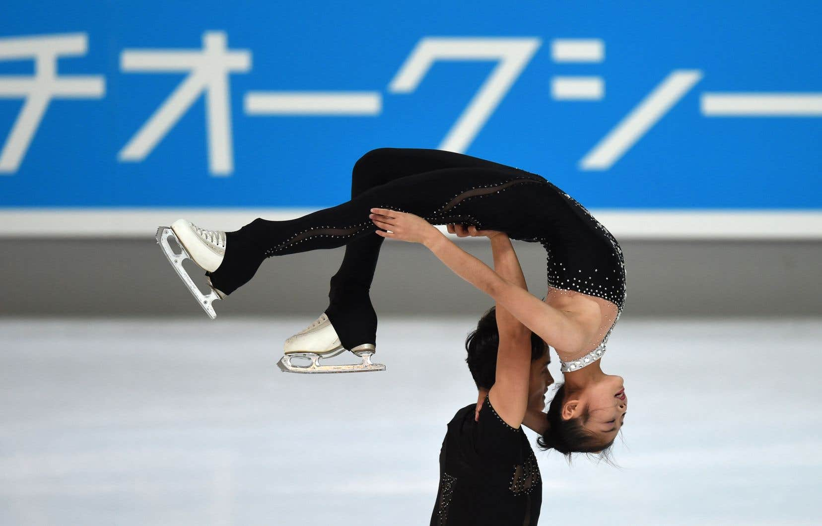 Les patineurs artistiques nord-coréens Ryom Tae-ok et Kim Ju-sik