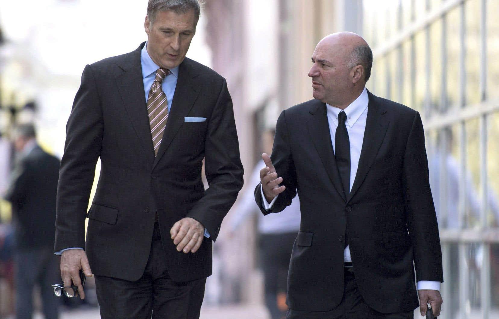 Les candidats Maxime Bernier et Kevin O'Leary affichent une dette respective de 250 000$ et plus de 500 000$.