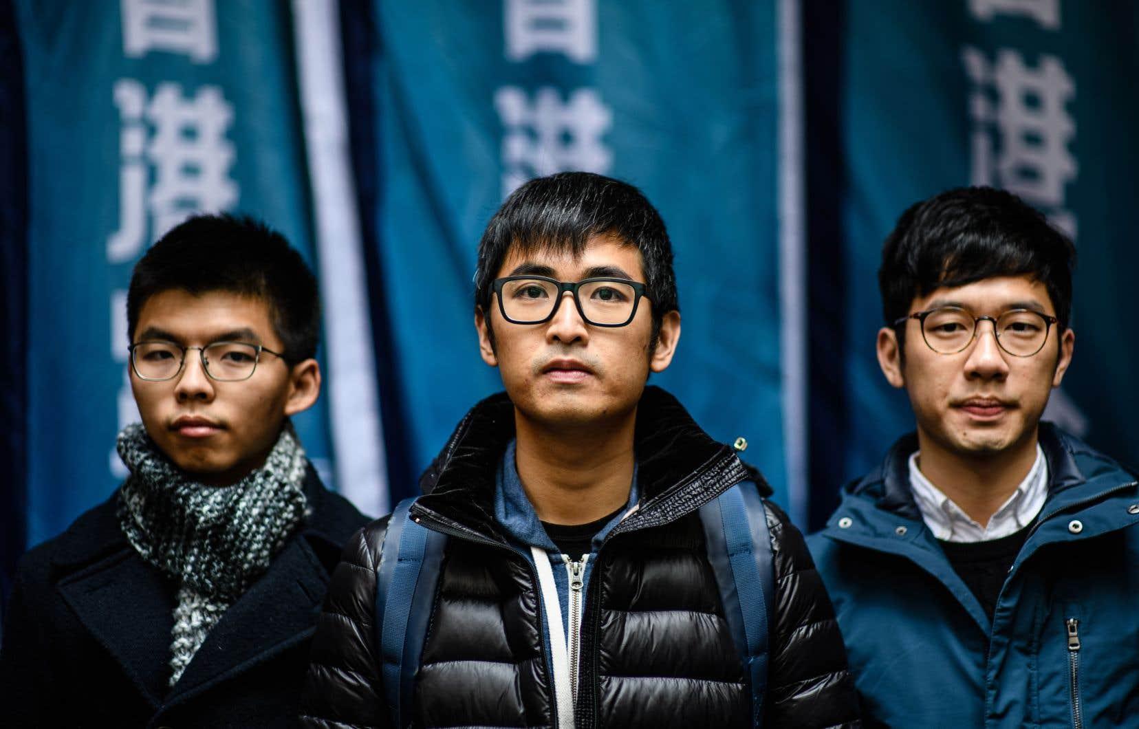 De gauche à droite: Joshua Wong, Nathan Law et Alex Chow