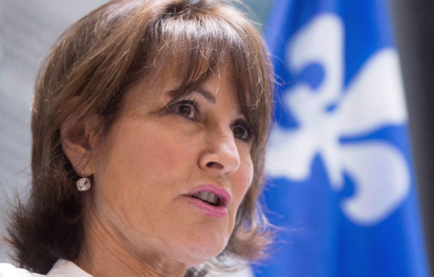 Un projet de loi sera dévoilé «sous peu», a promis, la main sur le coeur, Kathleen Weil lors d'une conférence de presse jeudi.