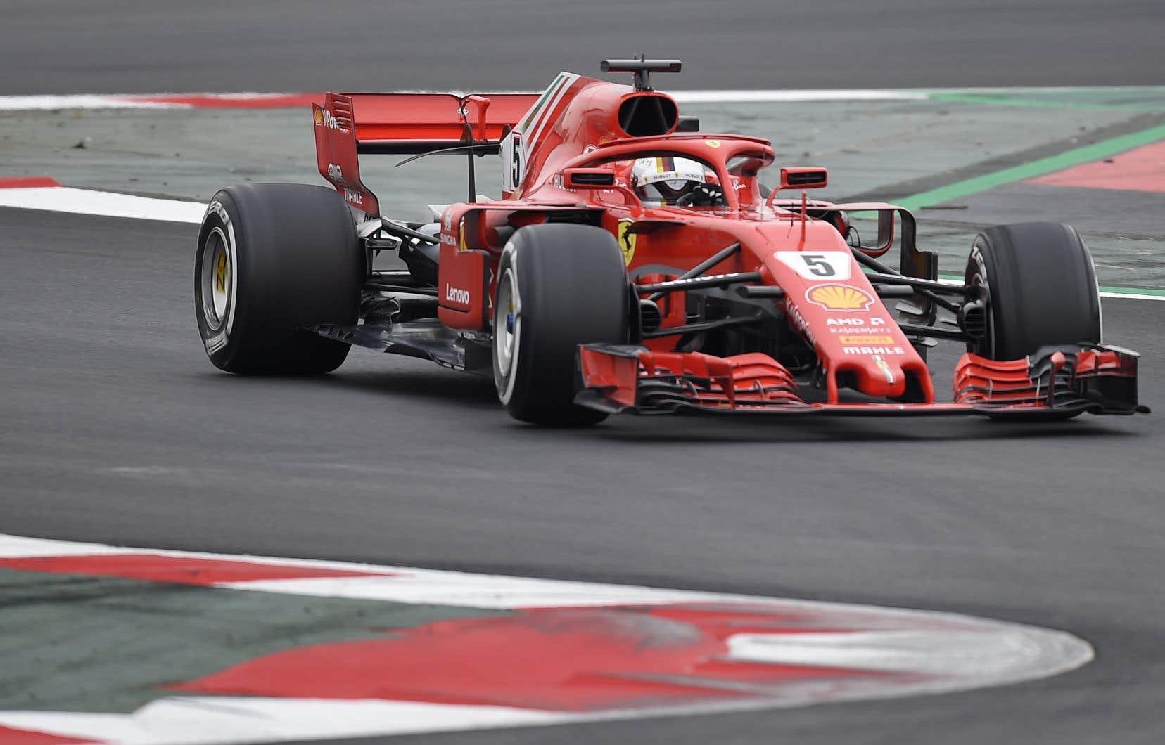 Vettel s'est imposé avec un chrono de 1 minute 19,673 secondes, lui qui effectuait ses premiers tours au volant de la nouvelle Ferrari.